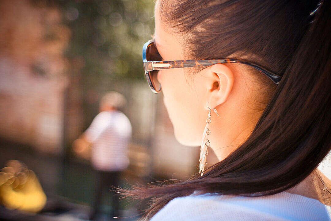 Download Brunette Wearing Sunglasses FREE Stock Photo