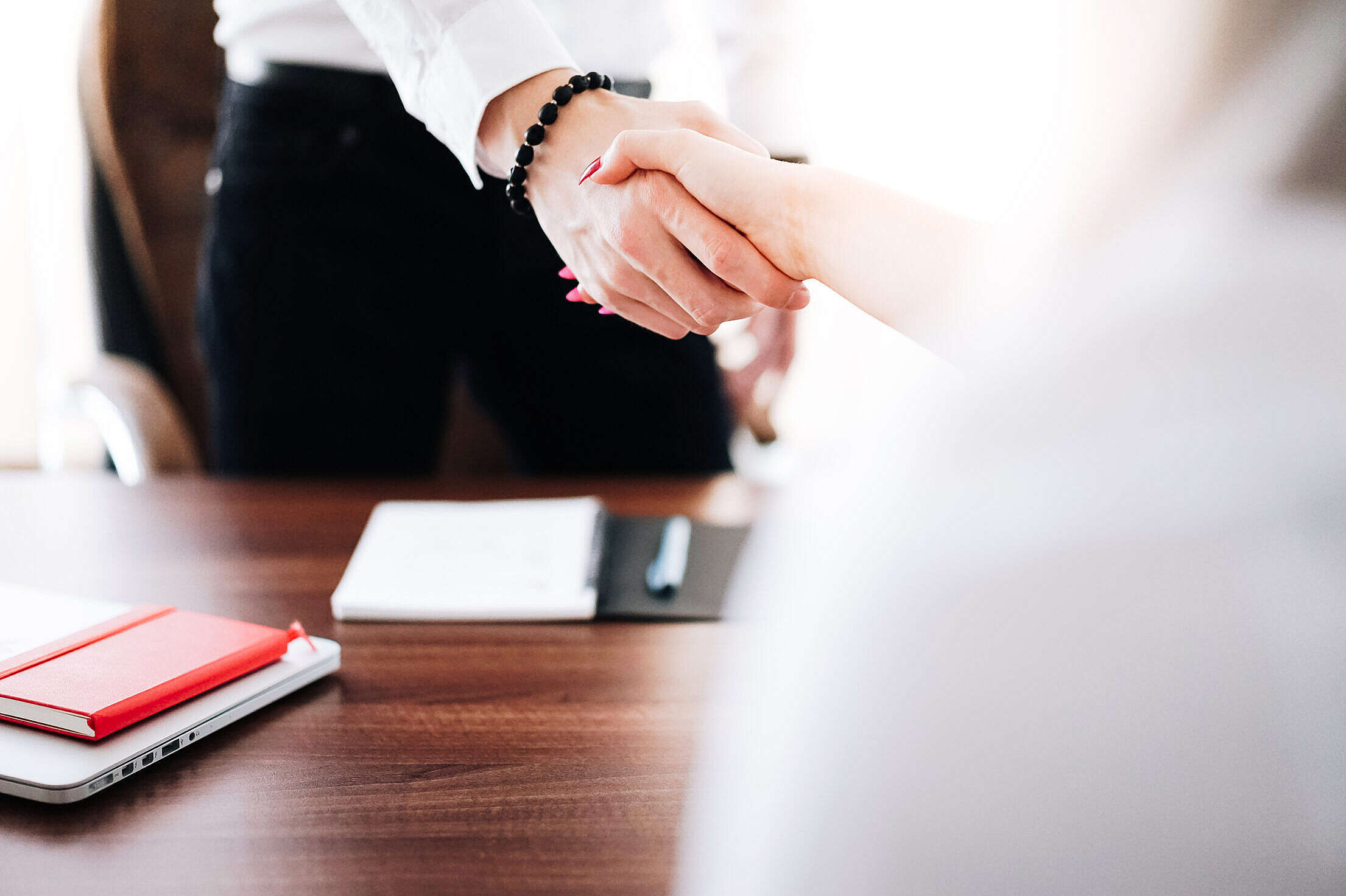 Business Man and Woman Handshake in Work Office Free Stock Photo
