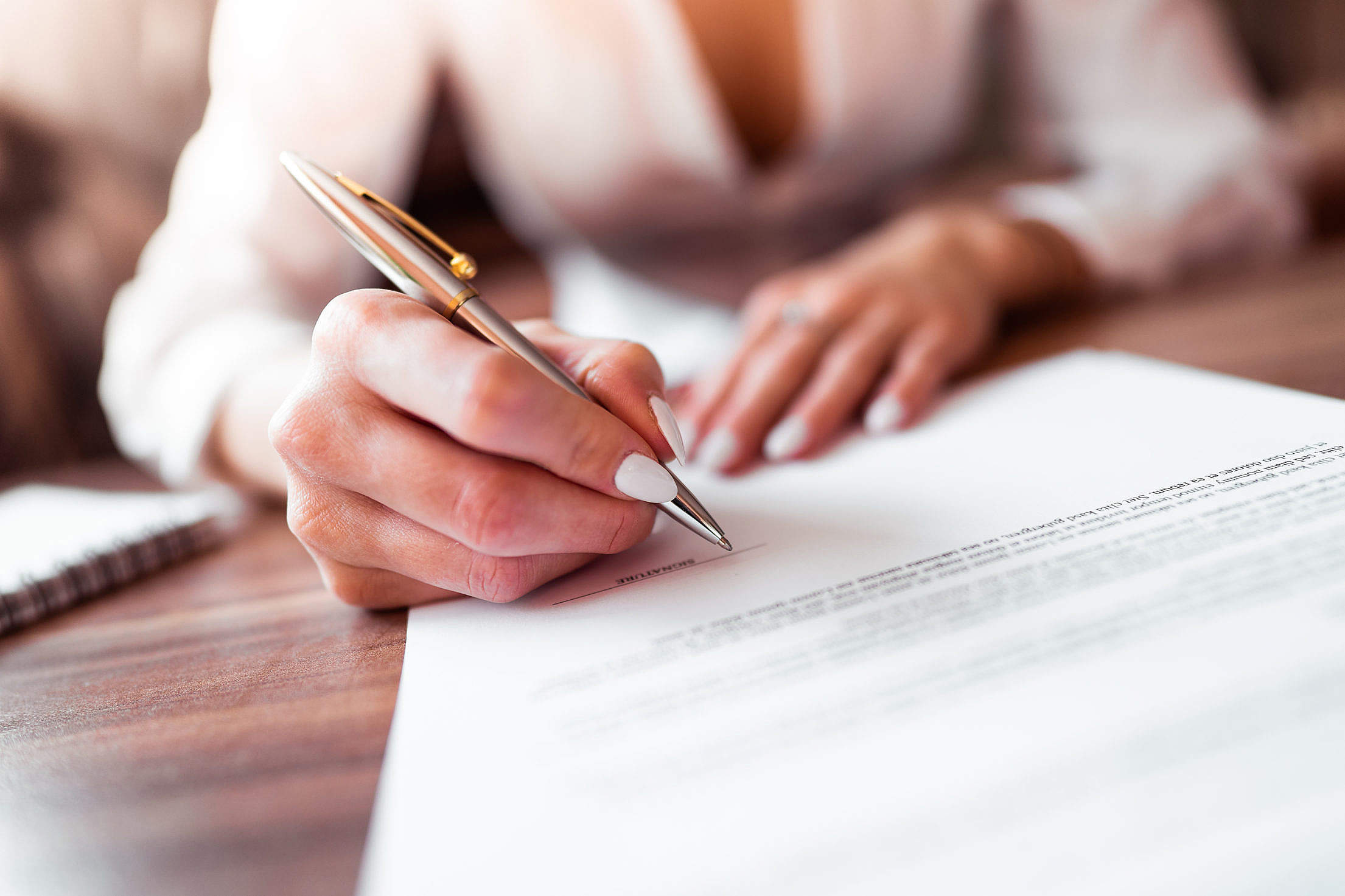 Business Woman Signing a Contract Free Stock Photo