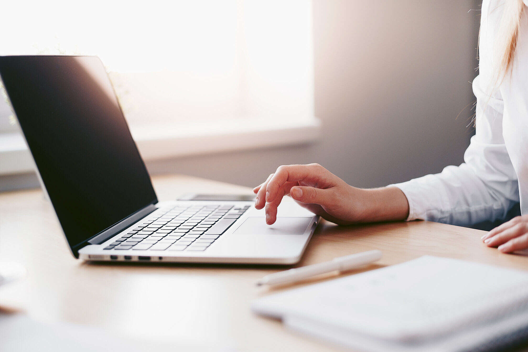 Business Woman Working on Laptop in Her Office Free Stock Photo