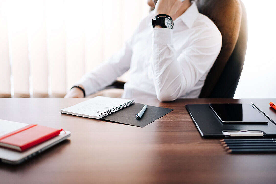 Download Businessman CEO Making a Phone Call in Office FREE Stock Photo