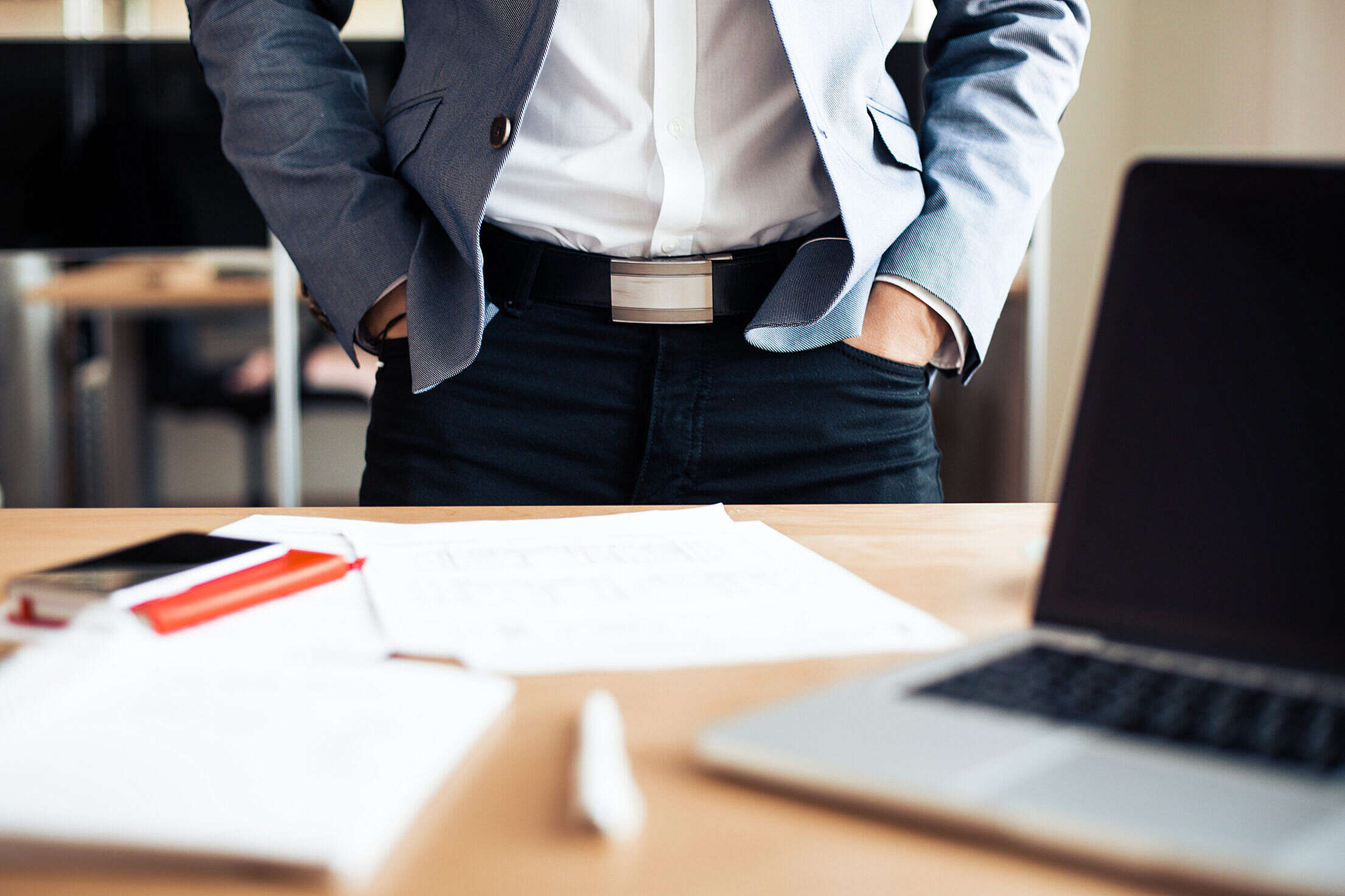 Businessman Standing in his Office Free Stock Photo