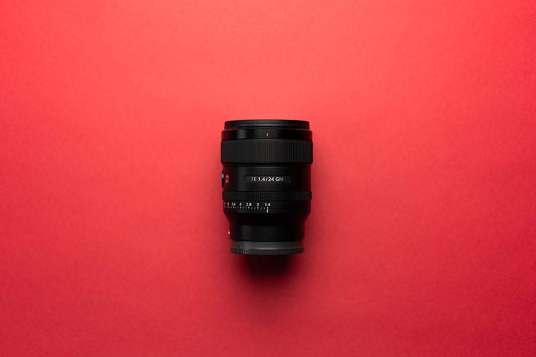 Download Camera Lens on a Red Background FREE Stock Photo
