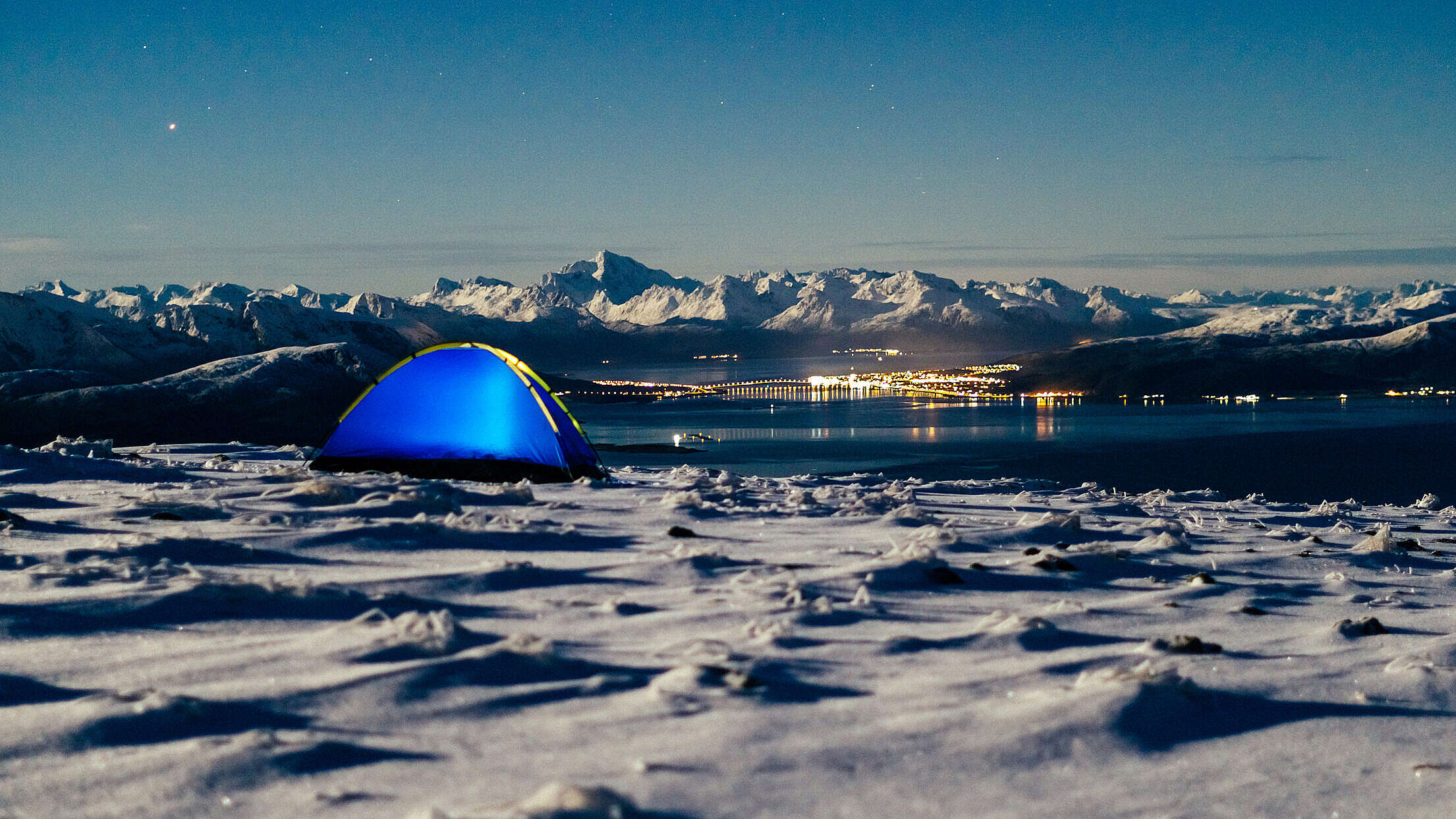 Camping Place on Snowy Mountain with Fjord View Free Stock Photo