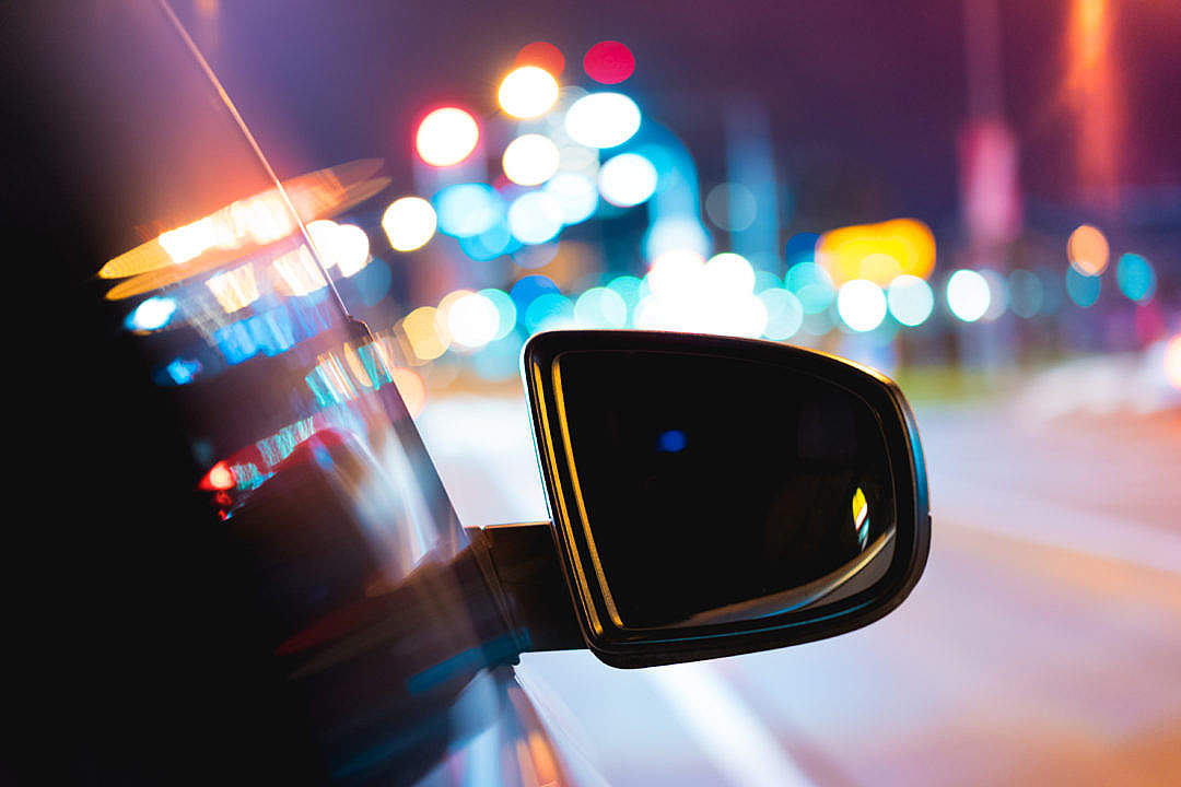 Download Car Side Rear-View Mirror with City Bokeh Lights FREE Stock Photo