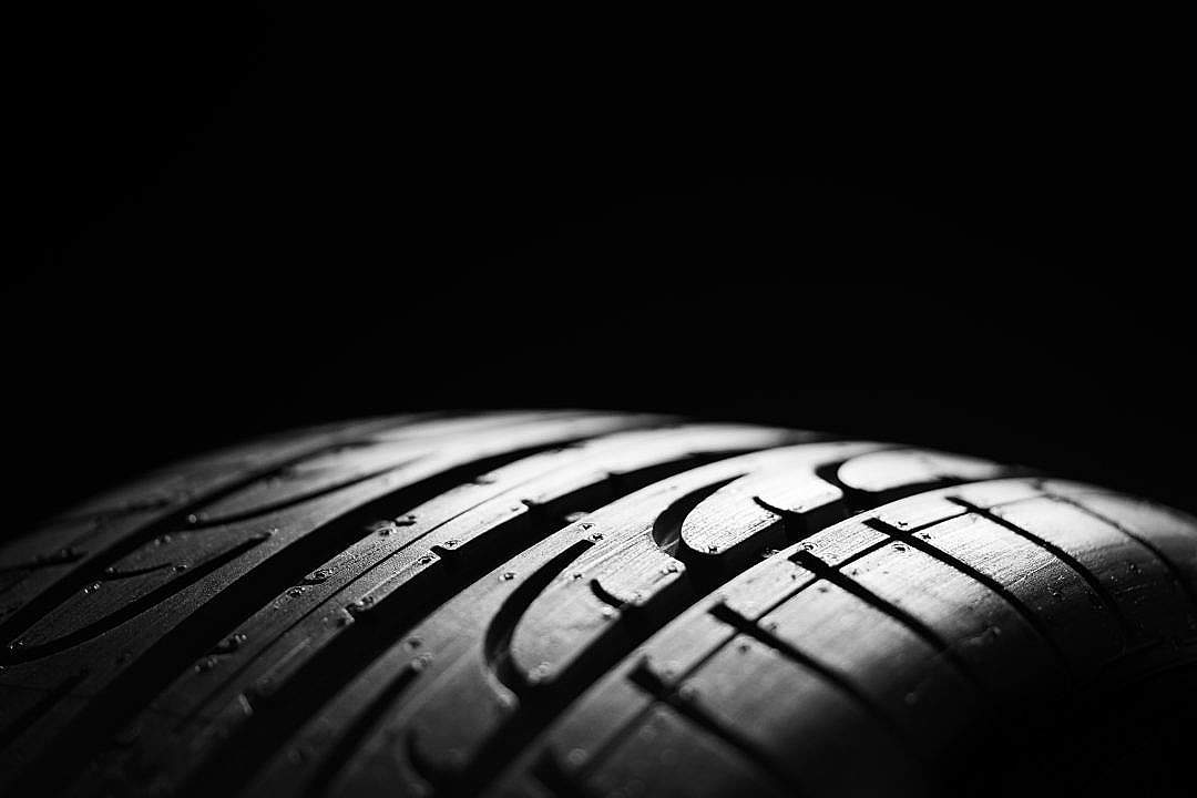 Download Car tire on a Black Background FREE Stock Photo