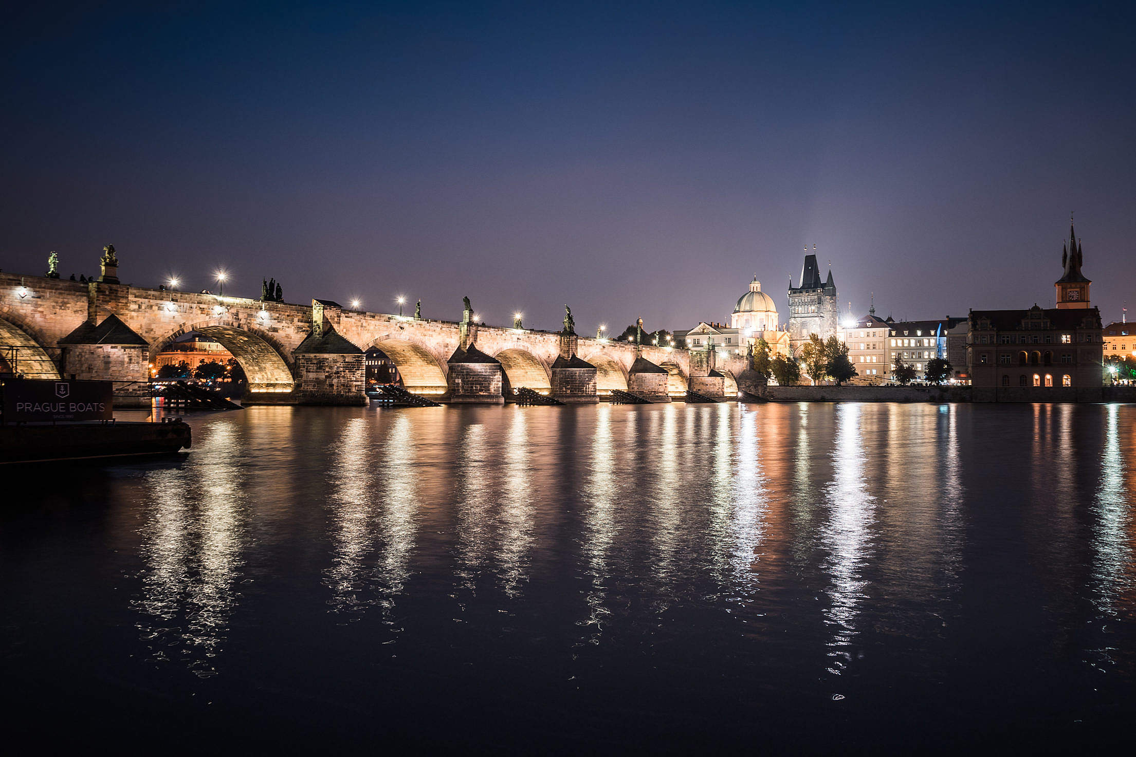 Charles Bridge and Vltava River in Prague at Night Free Stock Photo