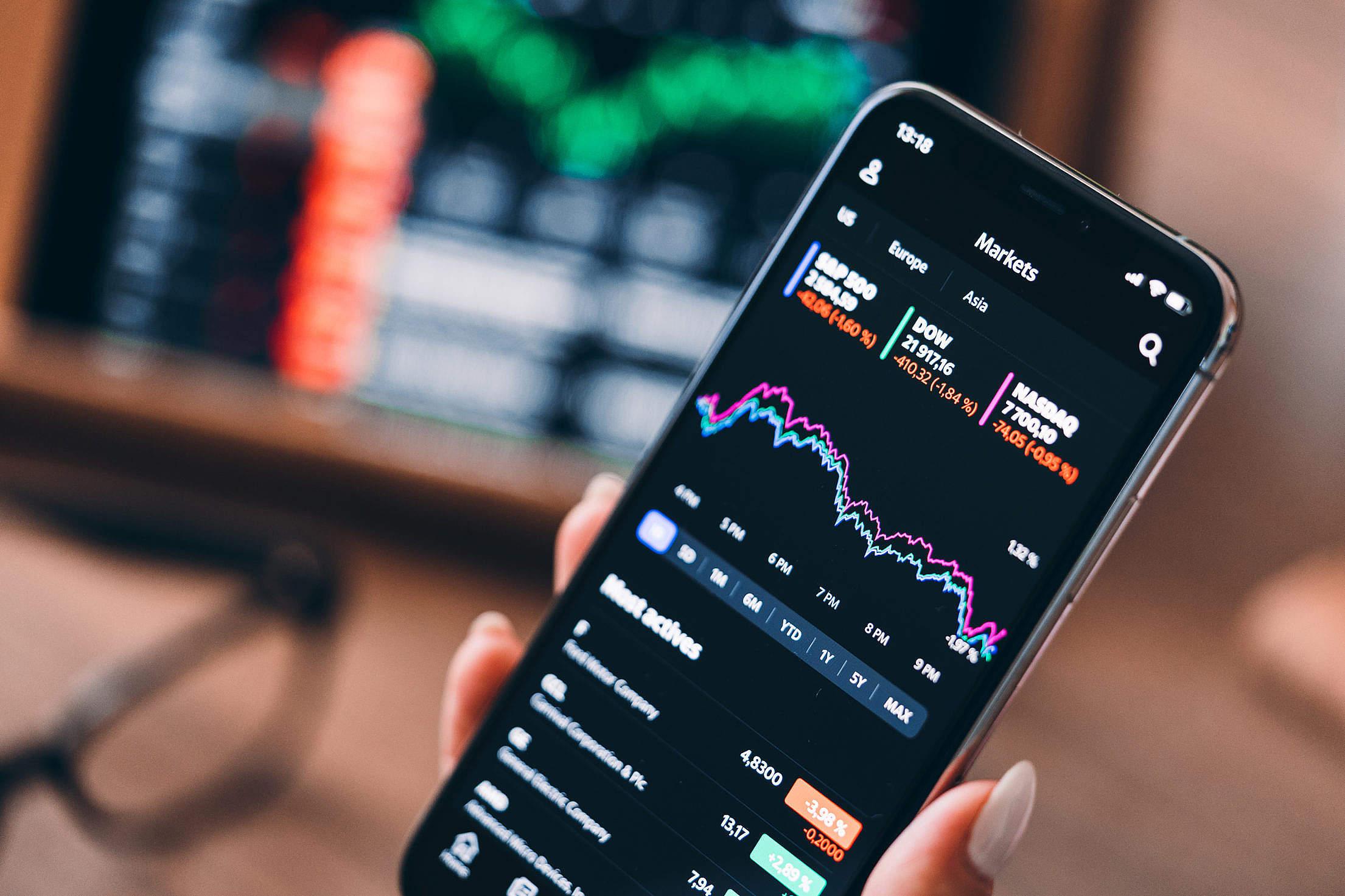 Checking Stock Market Data on Smartphone Free Stock Photo