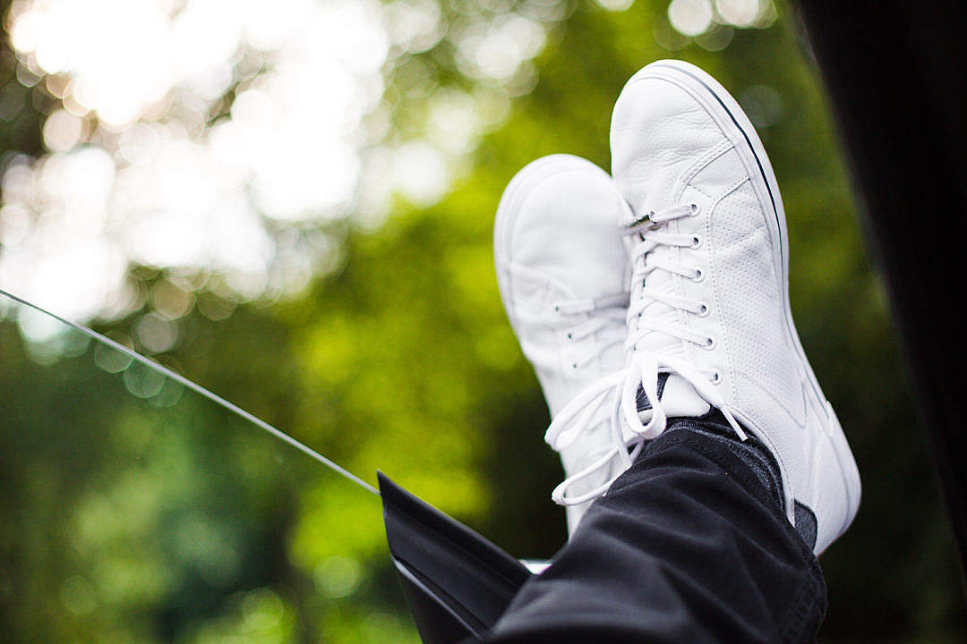 Download Chilling Out With White Sneakers On FREE Stock Photo