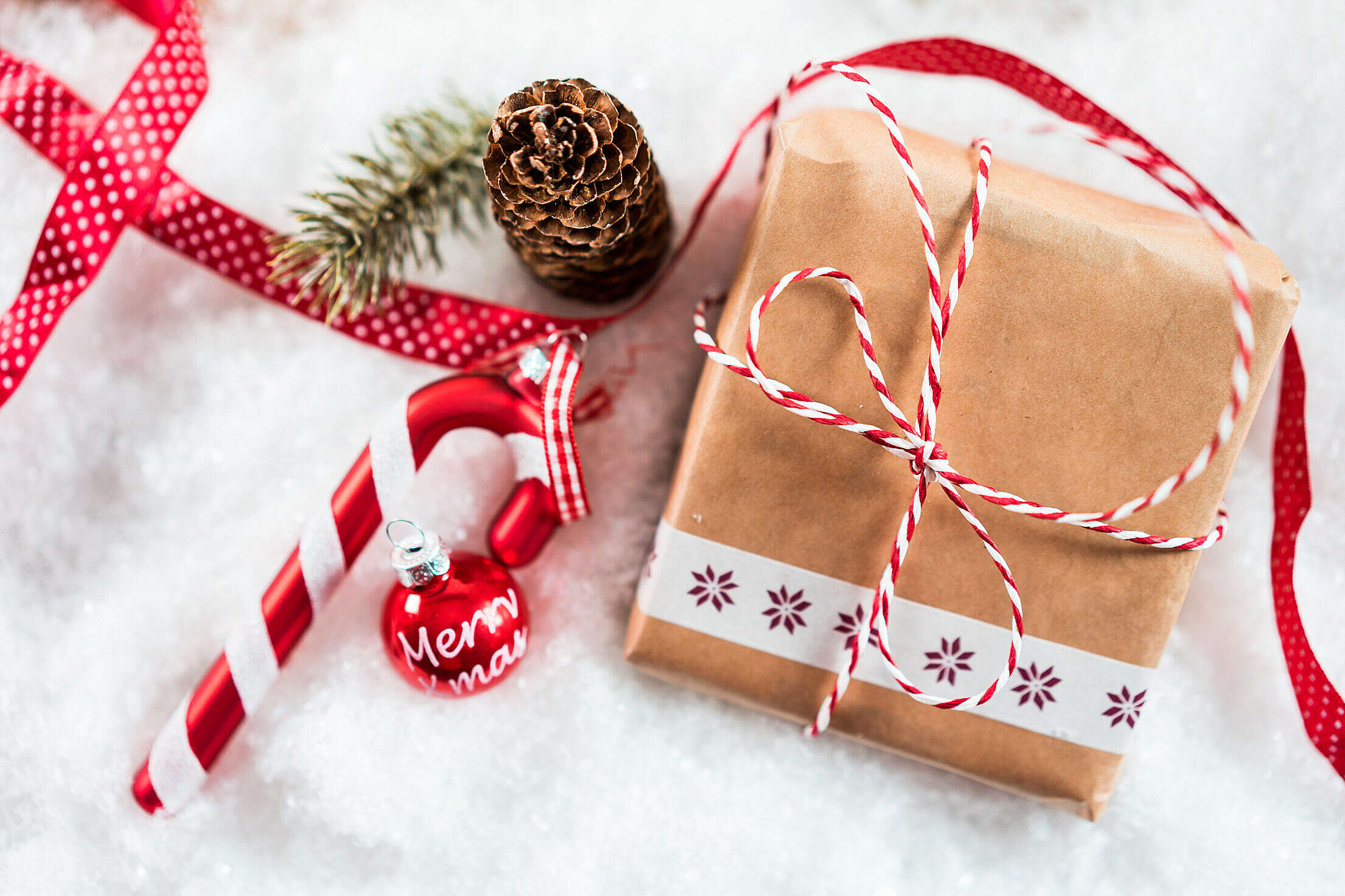 Christmas Present and Decorations in Snow Free Stock Photo