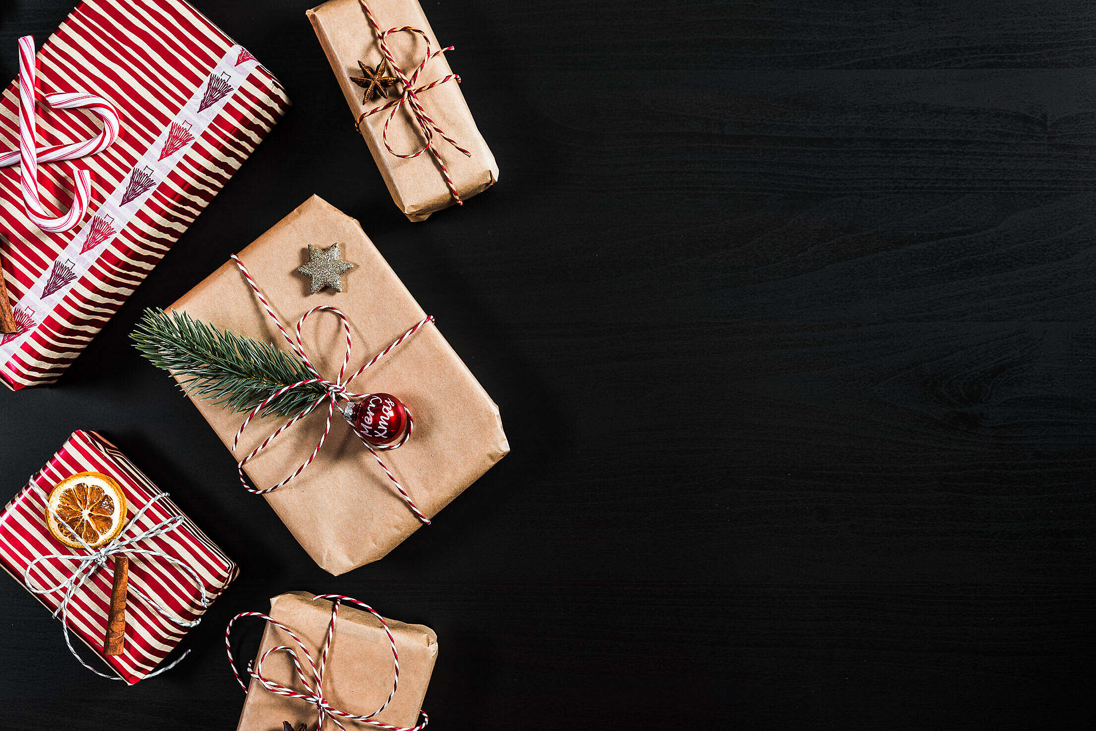 Christmas Presents with Black Background Room for Text Free Stock Photo