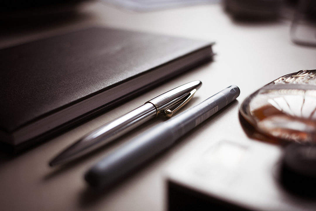 Download Chrome & Graphic Pens with a Diary FREE Stock Photo