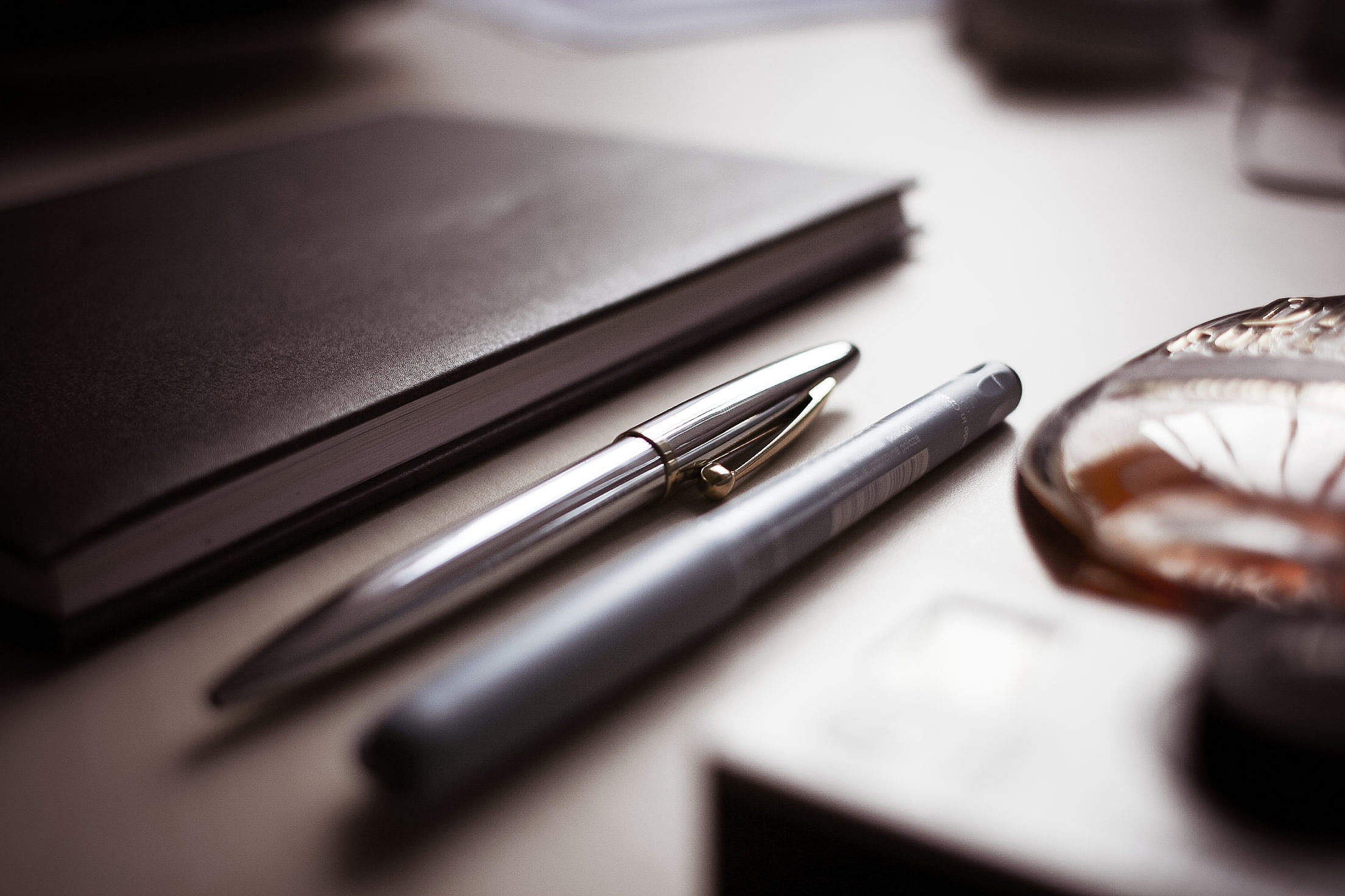 Chrome & Graphic Pens with a Diary Free Stock Photo