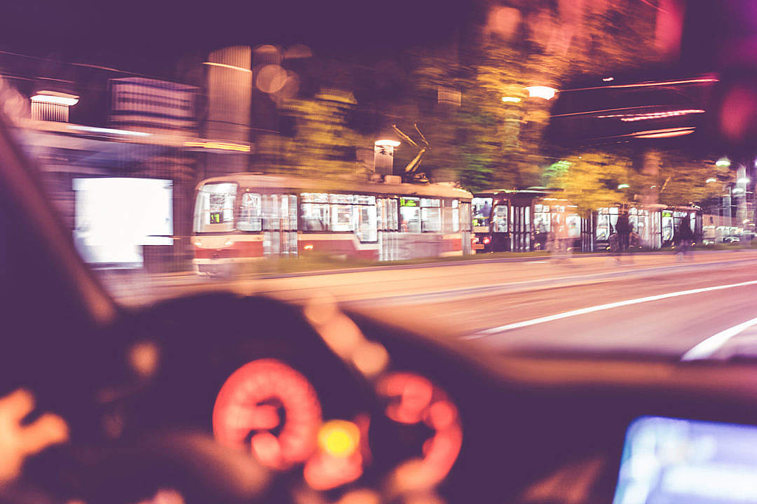 Download City Tram vs. Car Going Together at Night FREE Stock Photo