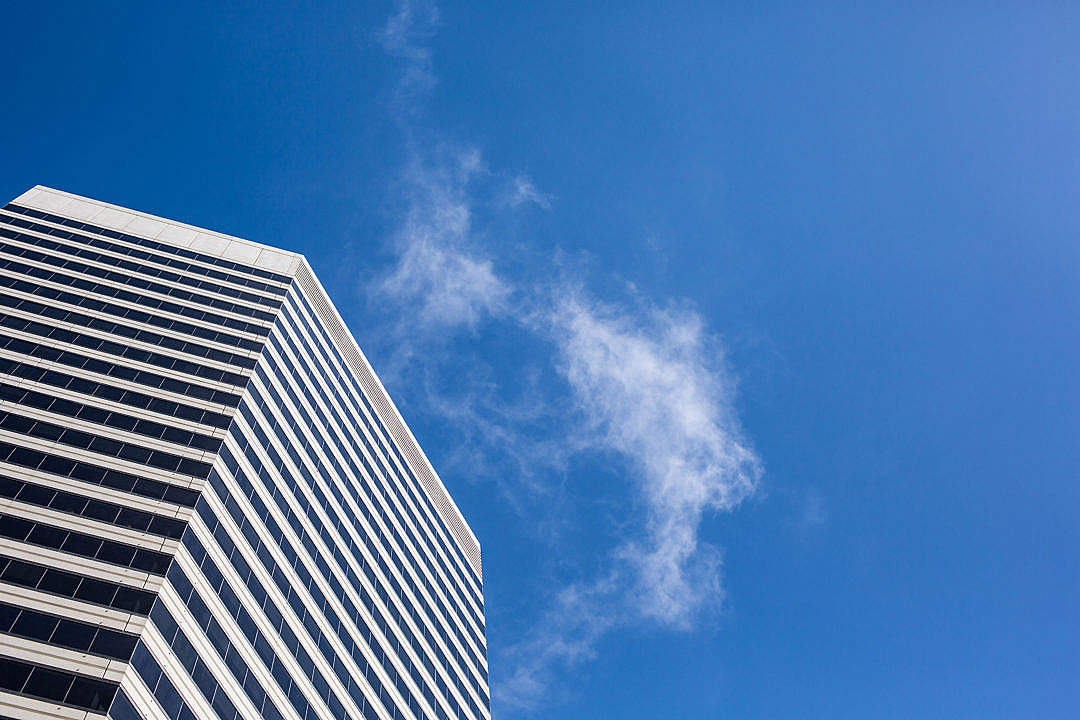 Download Clean Skyscraper View from Below Against a Blue Sky FREE Stock Photo