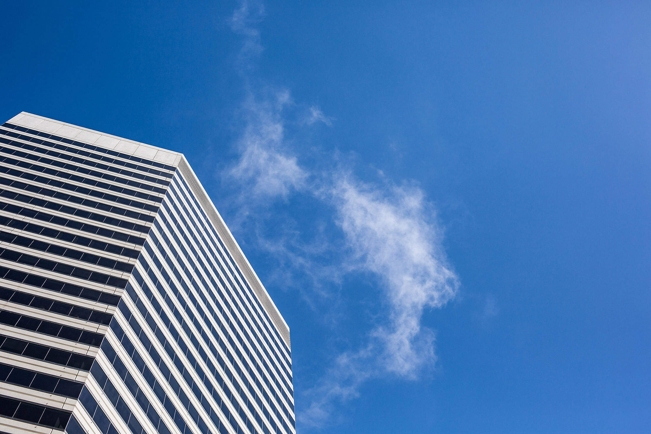 Clean Skyscraper View from Below Against a Blue Sky Free Stock Photo