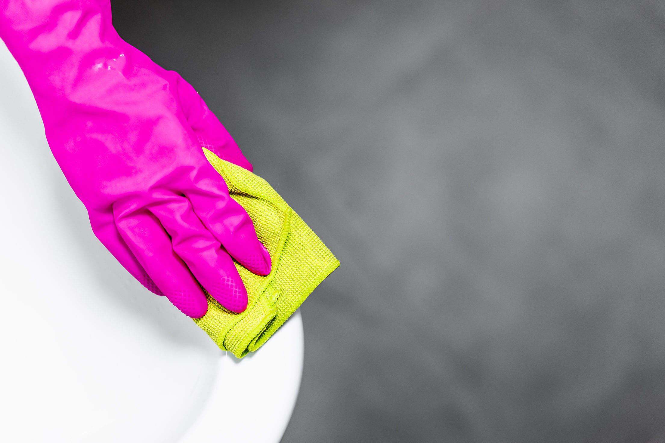 Cleaning Service Polishing a Ceramic Wash Basin Free Stock Photo