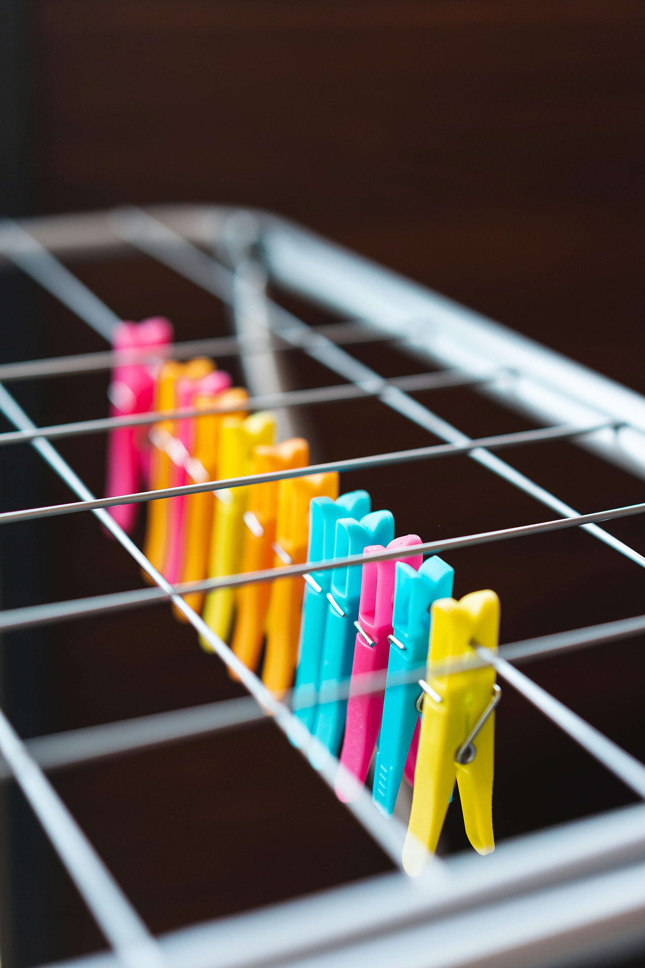 Clothes Dryer with Color Plastic Pegs Free Stock Photo