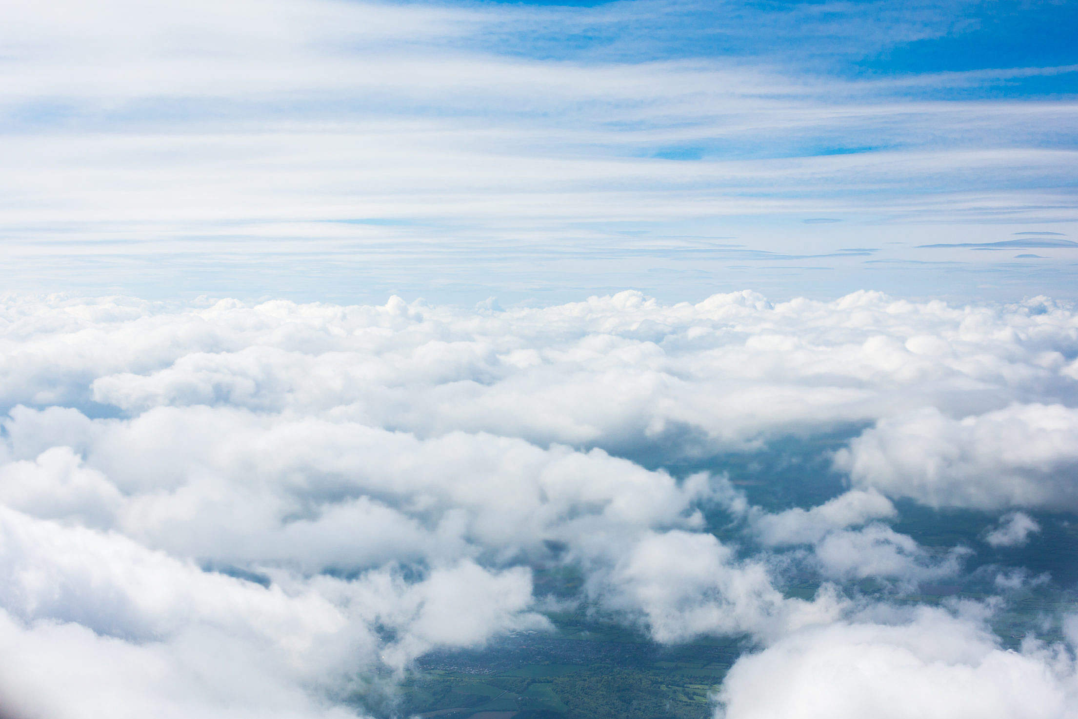 Clouds from an Airplane Window Free Stock Photo