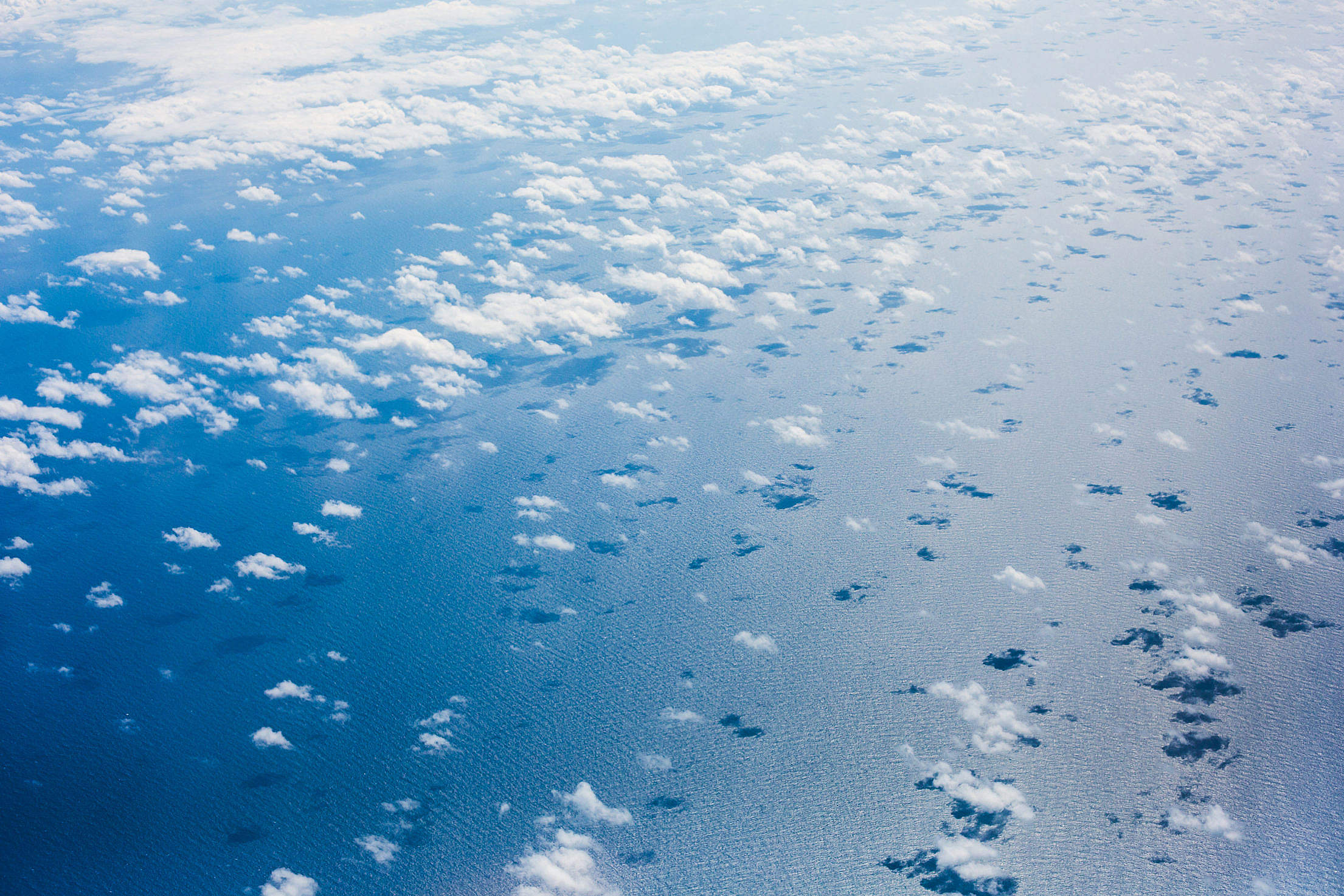 Clouds over the Pacific Ocean from an Airplane Free Stock Photo