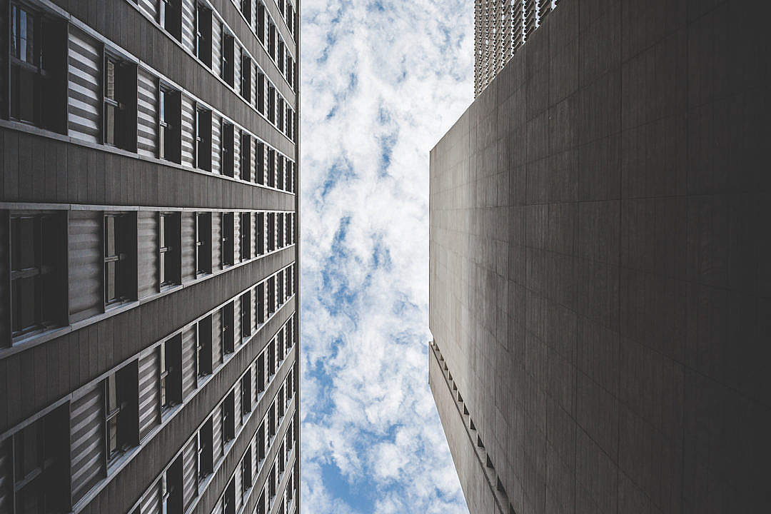 Download Cloudy Sky Between Two Skyscrapers Buildings FREE Stock Photo