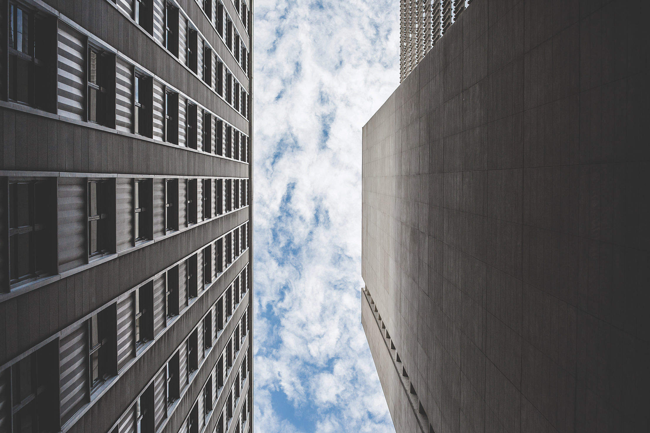 Cloudy Sky Between Two Skyscrapers Buildings Free Stock Photo