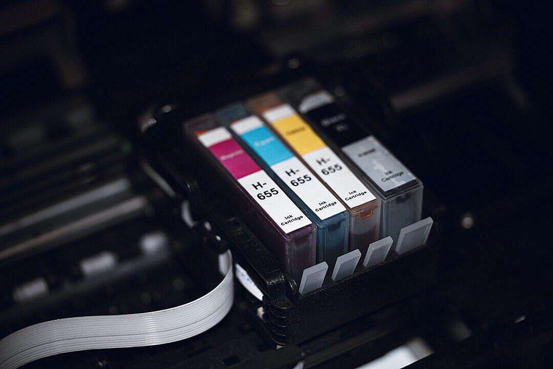 Download CMYK Printing Cartridges in Printer FREE Stock Photo