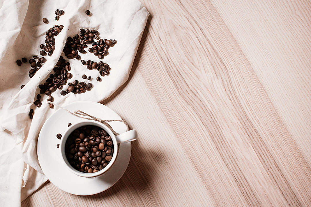 Download Coffee Beans in a Coffee Cup FREE Stock Photo
