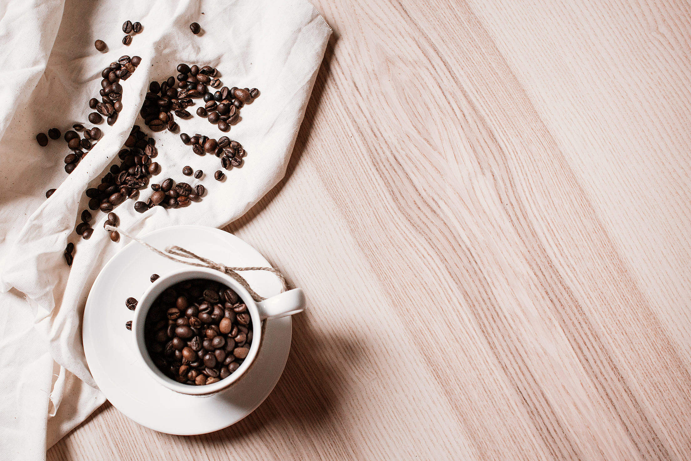 Coffee Beans in a Coffee Cup Free Stock Photo