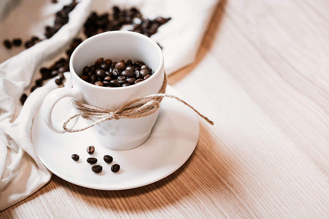 Download Coffee Beans in a Mug FREE Stock Photo