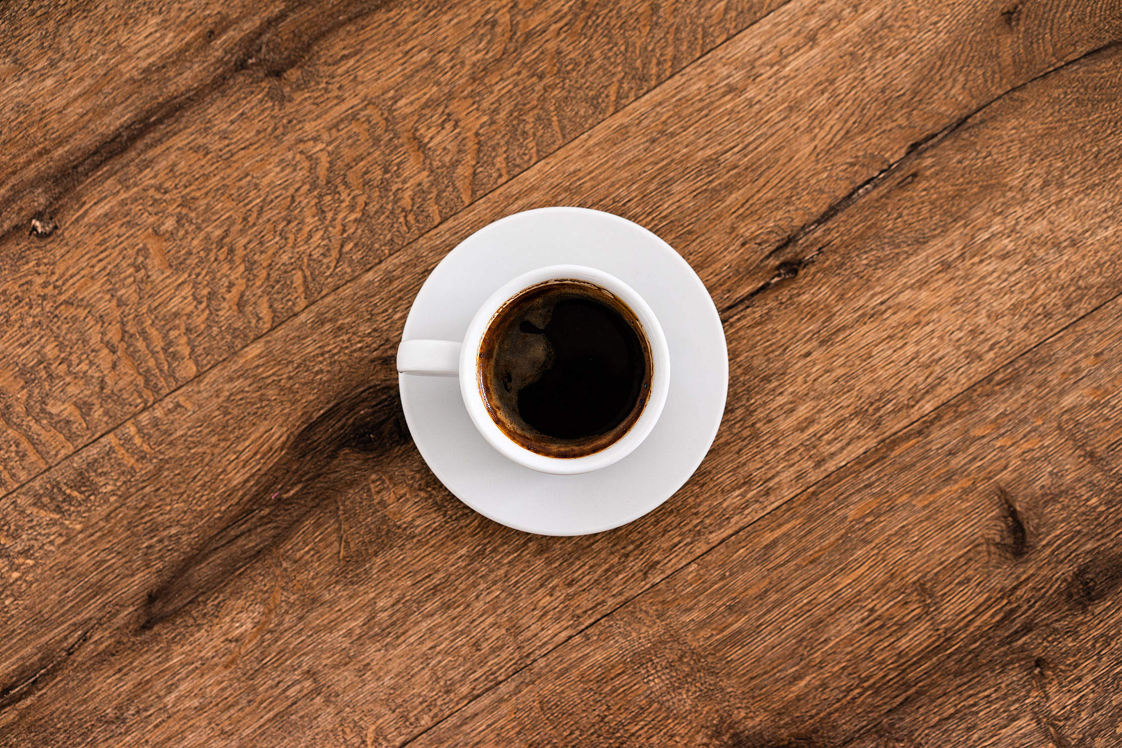 Coffee Cup on a Wooden Table Free Stock Photo