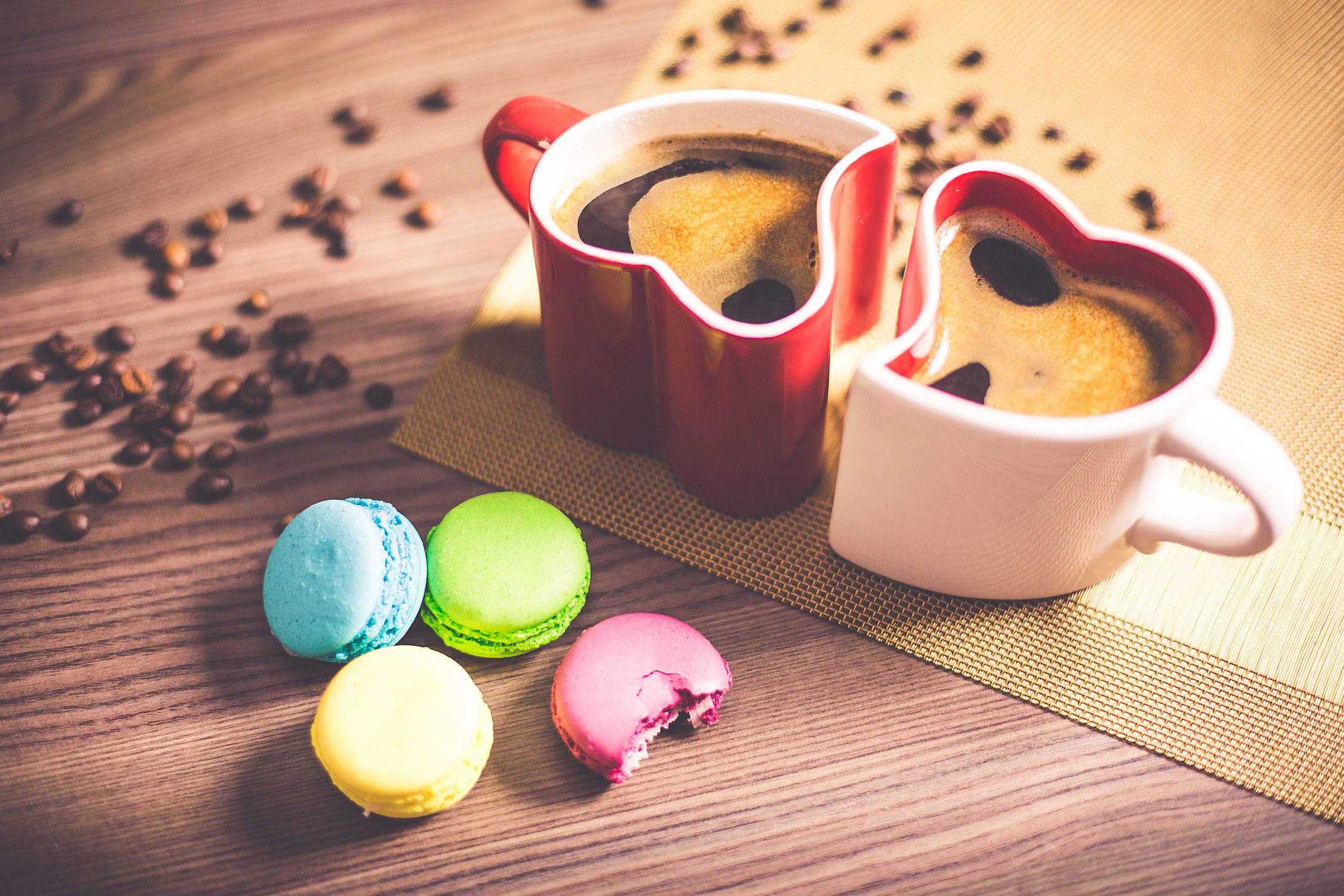 Coffee in Heart Cups and Sweet Yummy Macarons Free Stock Photo