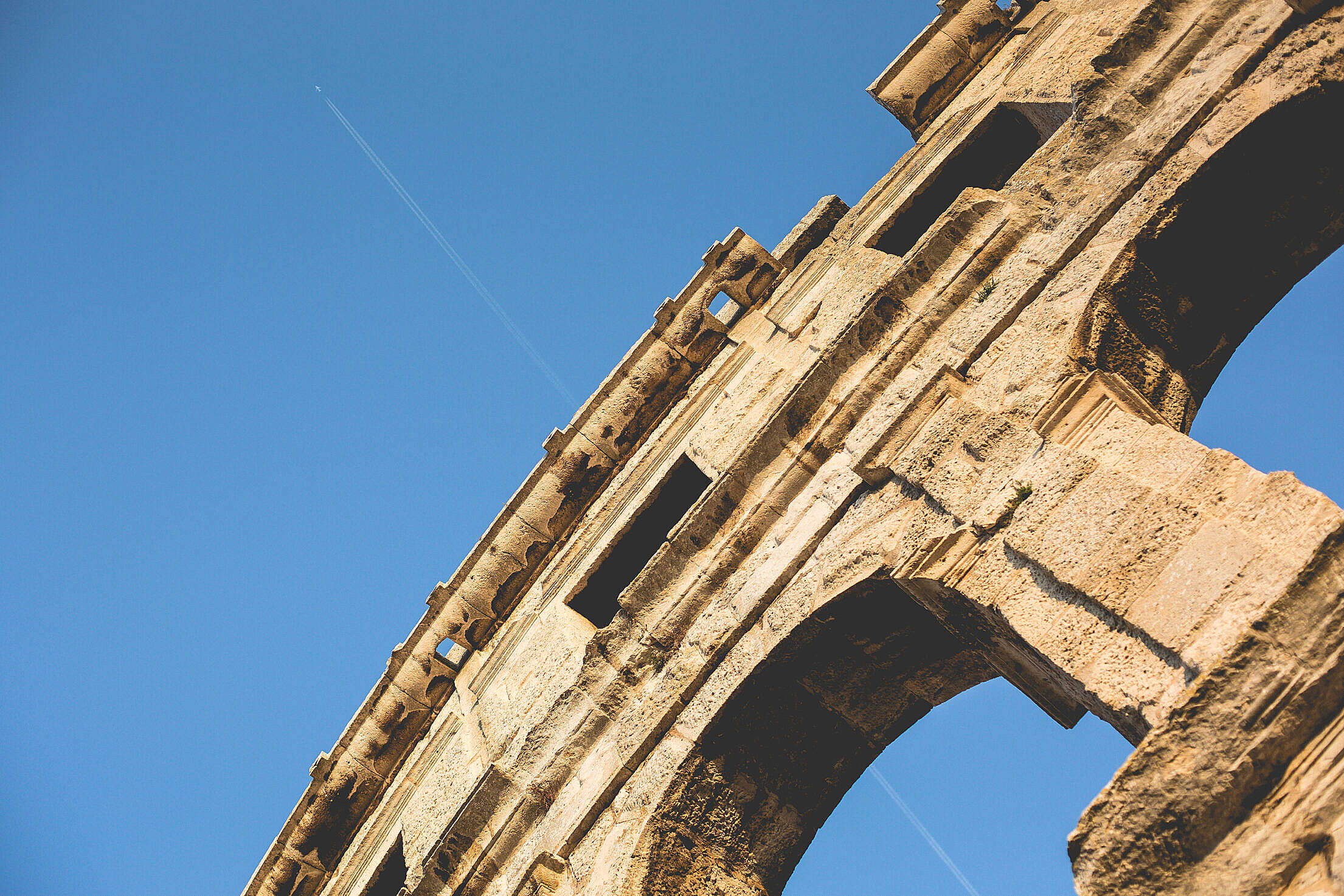Coliseum in Pula with Plane Free Stock Photo