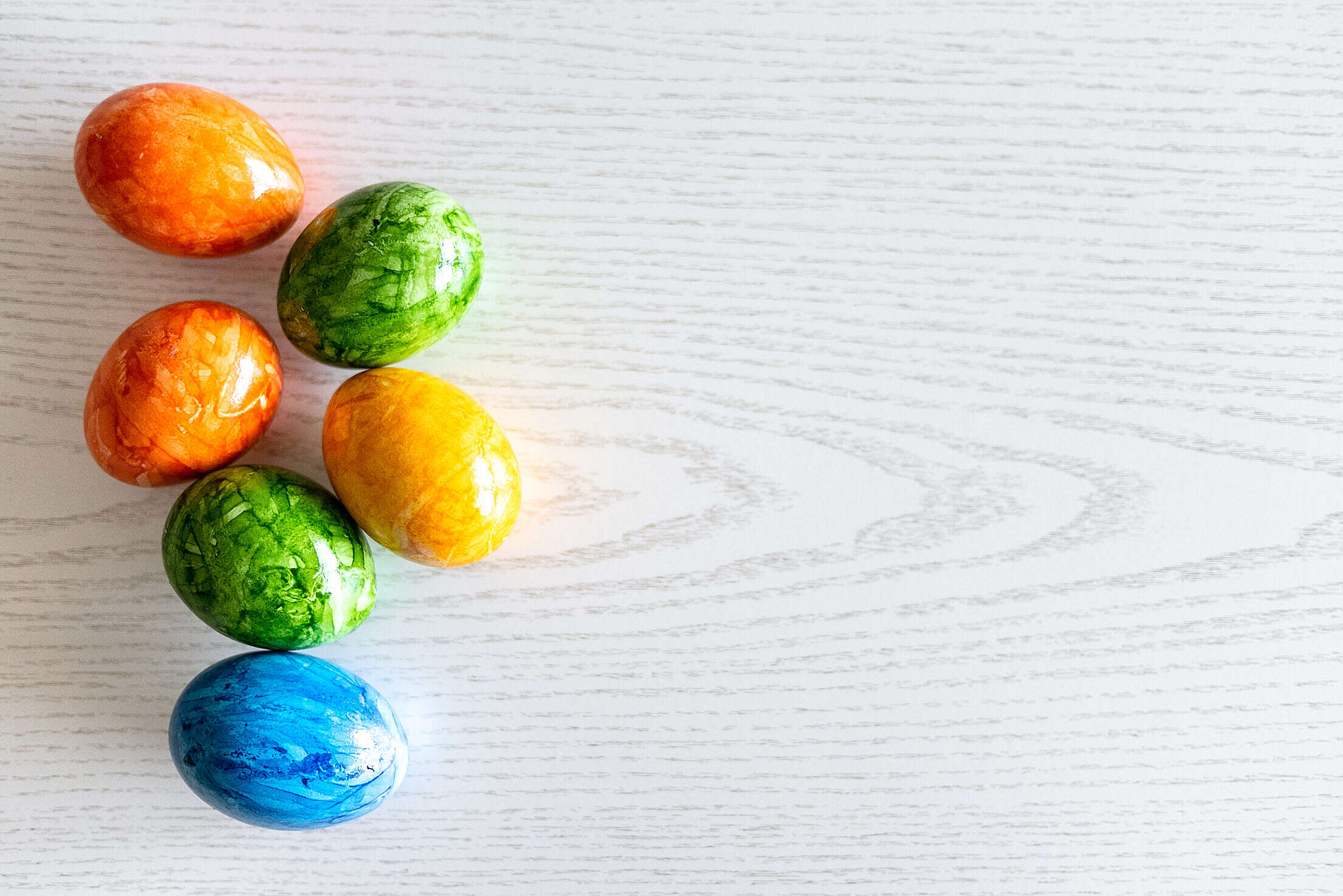 Colored Easter Eggs and Space for Text Free Stock Photo