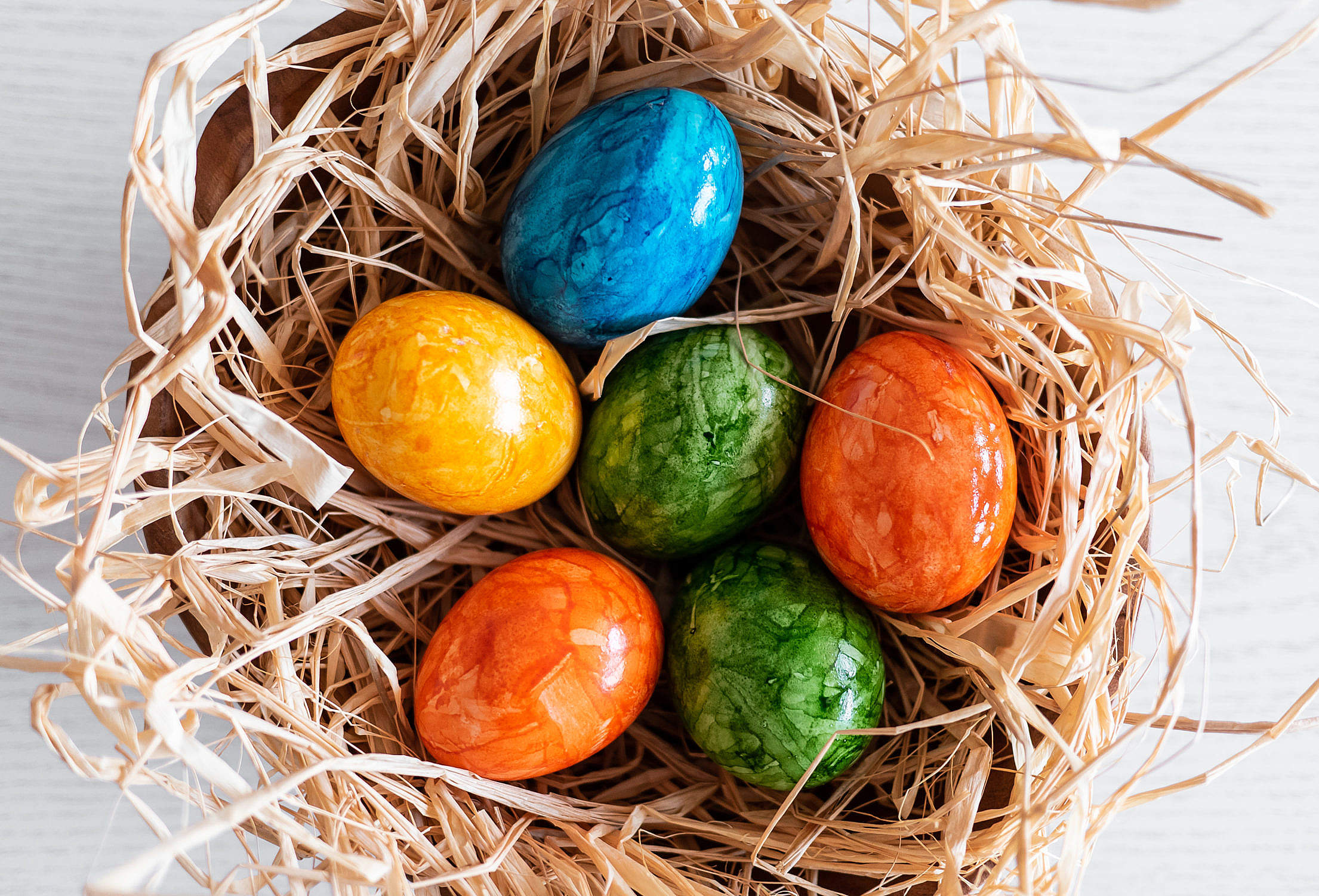Colored Easter Eggs in a Basket Free Stock Photo