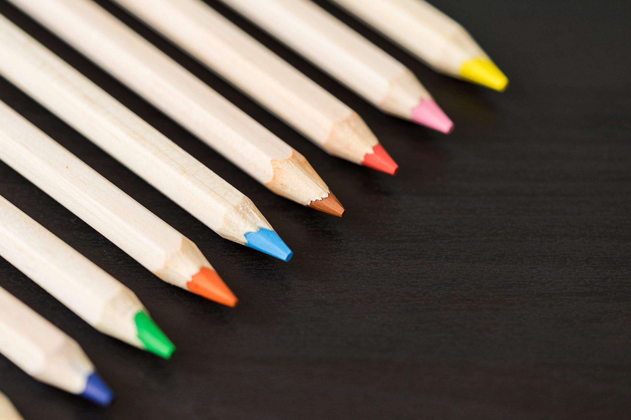 Colored Pencils in a Row with Room for Text Free Stock Photo