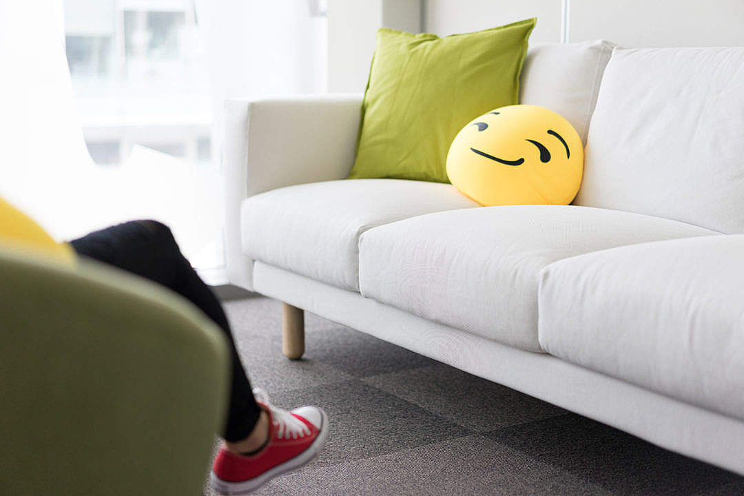 Download Colorful and Funny Pillows on Sofa in Modern Startup Office FREE Stock Photo