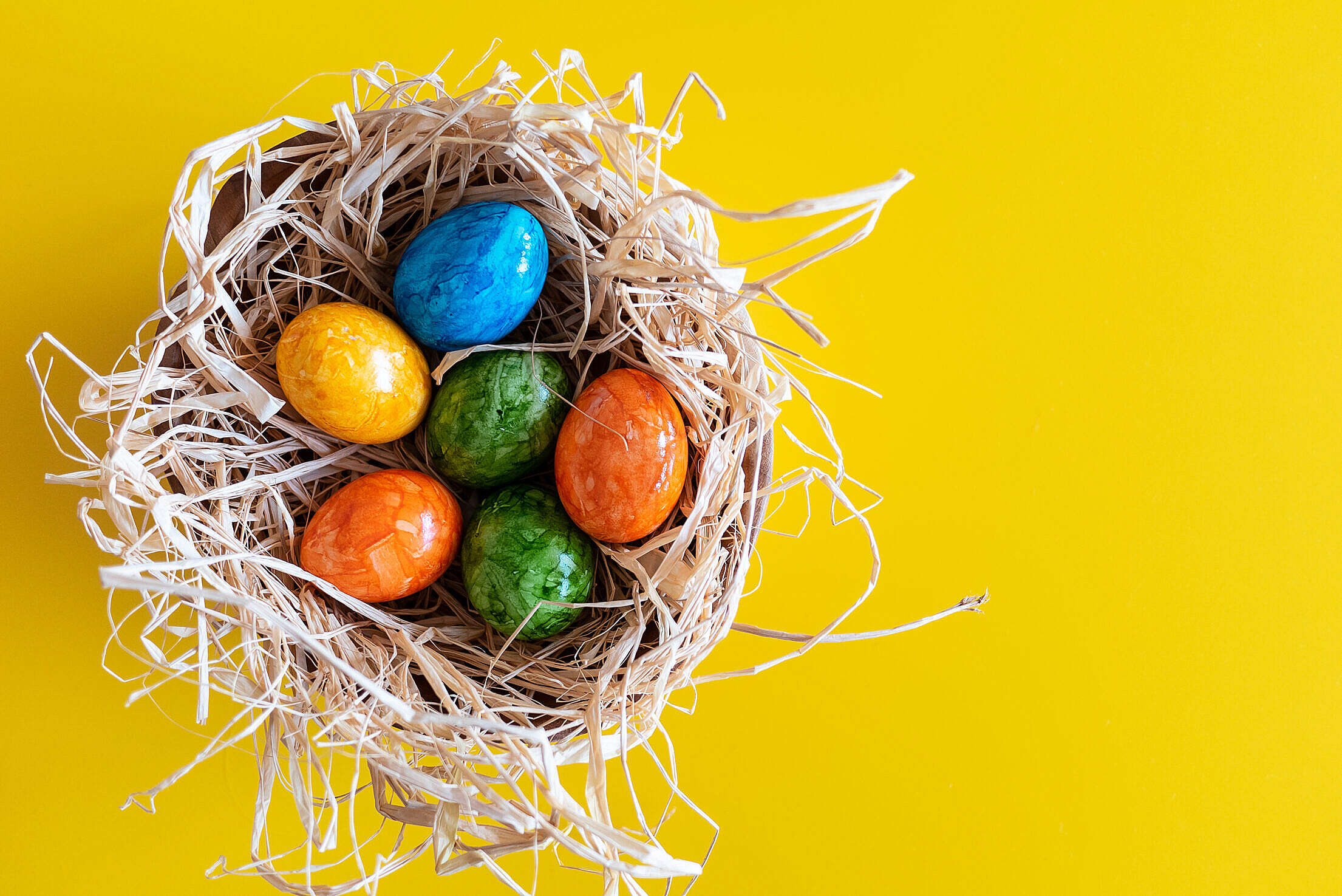 Colorful Easter Eggs on Yellow Background Free Stock Photo