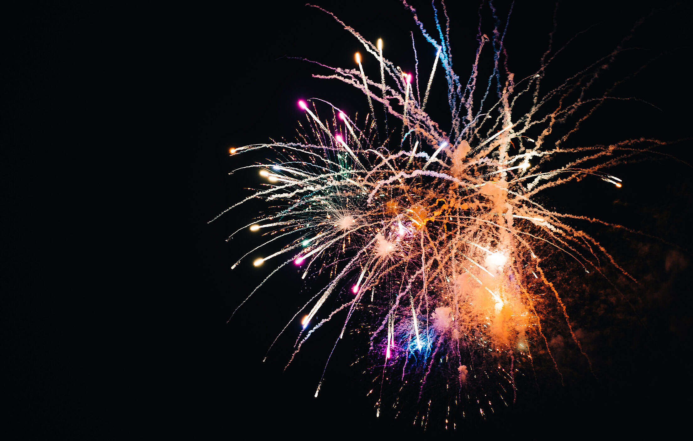 Colorful Fireworks Against Black Sky Free Stock Photo