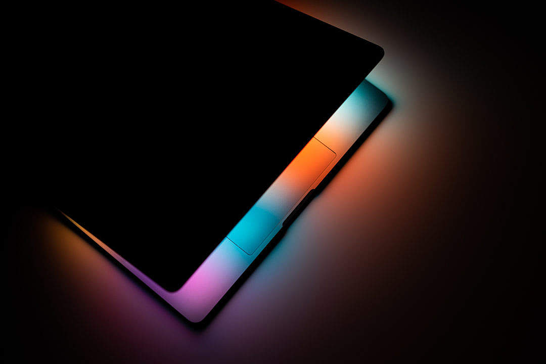 Download Colorful Lights Shines from MacBook Pro FREE Stock Photo