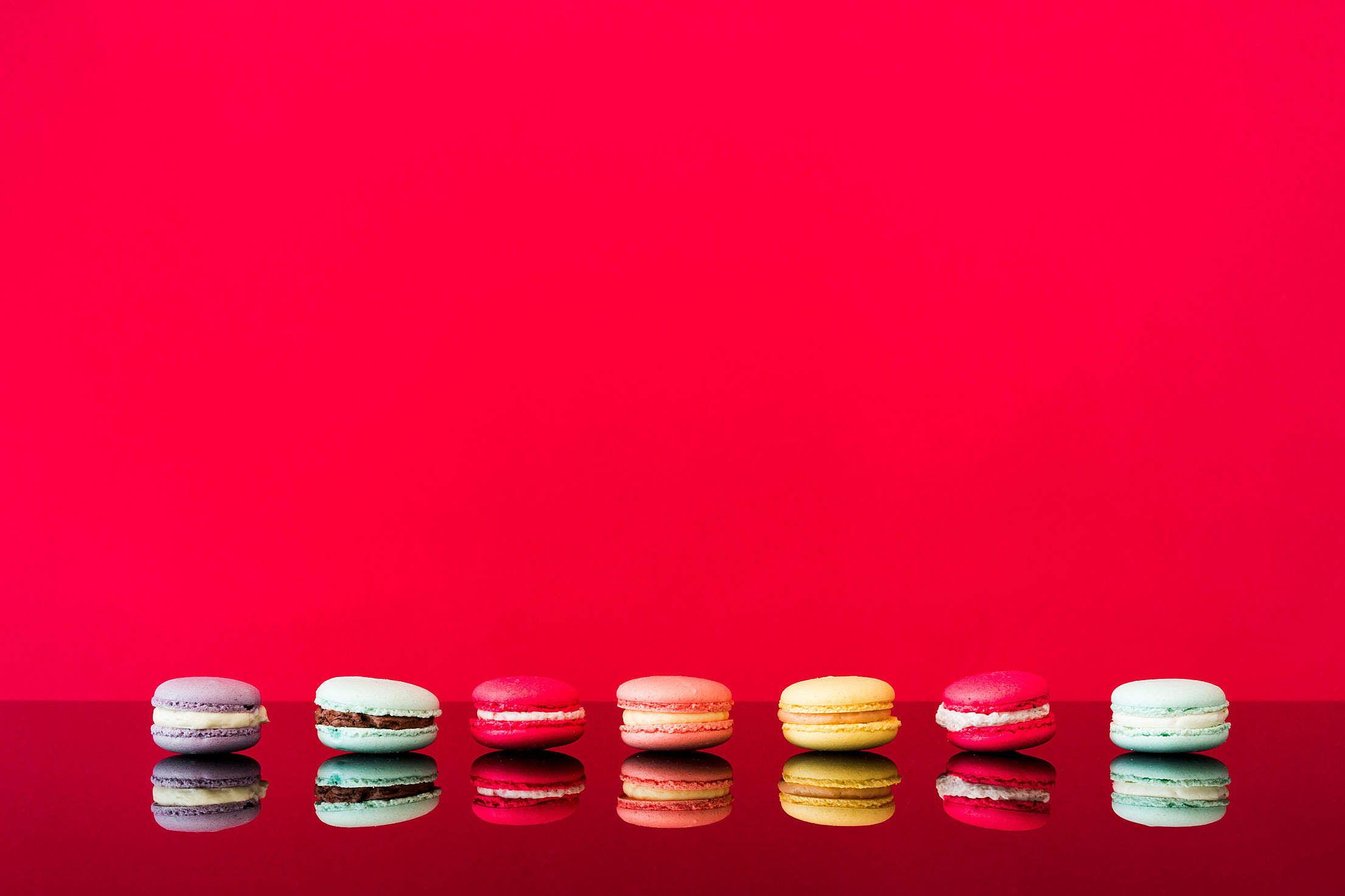 Colorful Macarons on a Glass Table Free Stock Photo