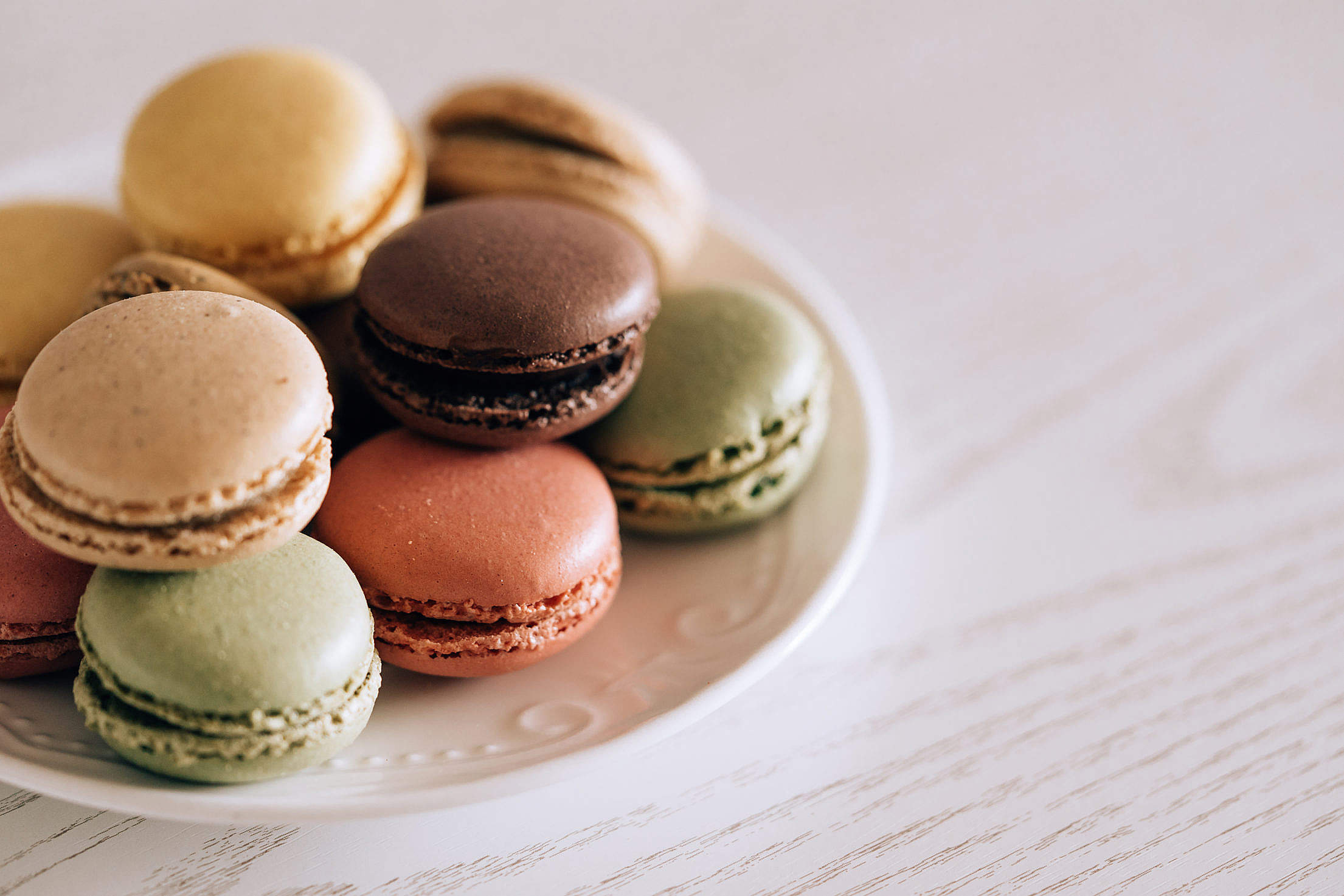 Colorful Macarons on a Vintage Plate Free Stock Photo