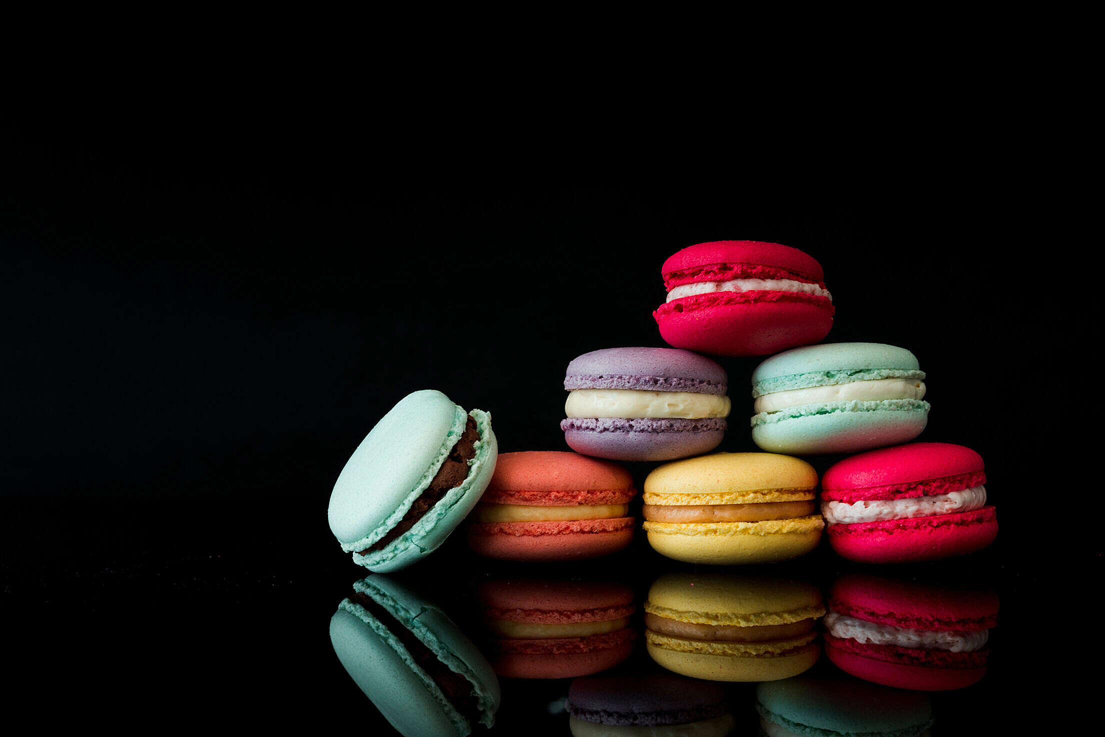 Colorful Macarons Still Life Black Background Free Stock Photo