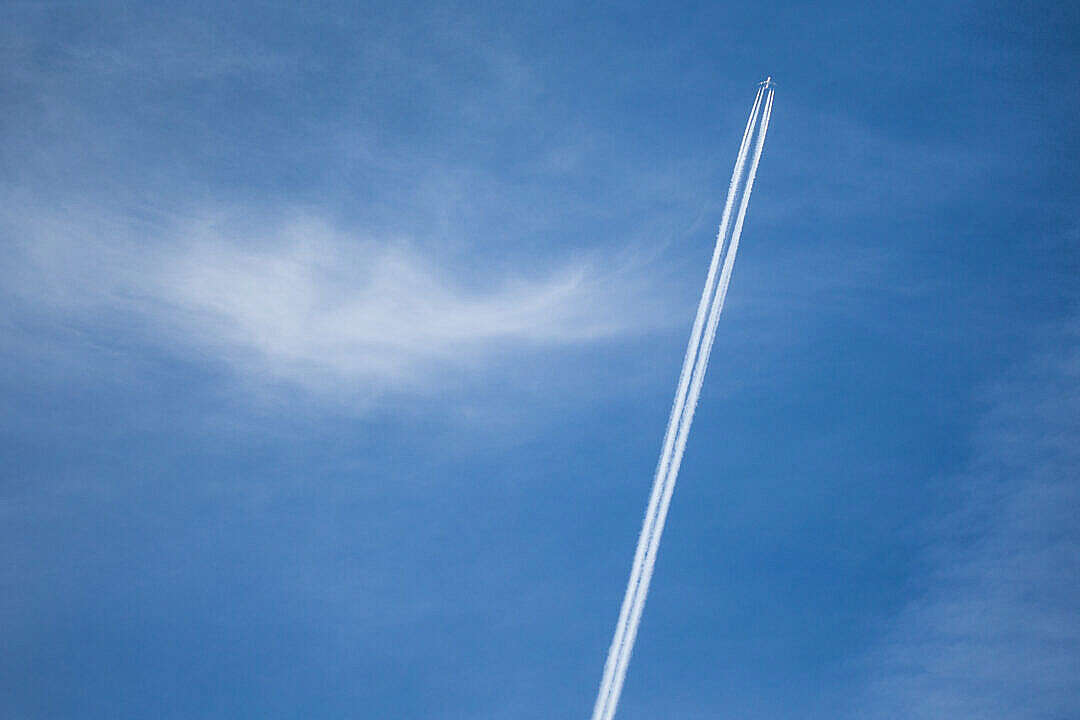 Download Contrails from Big Four-Engine Airplane FREE Stock Photo
