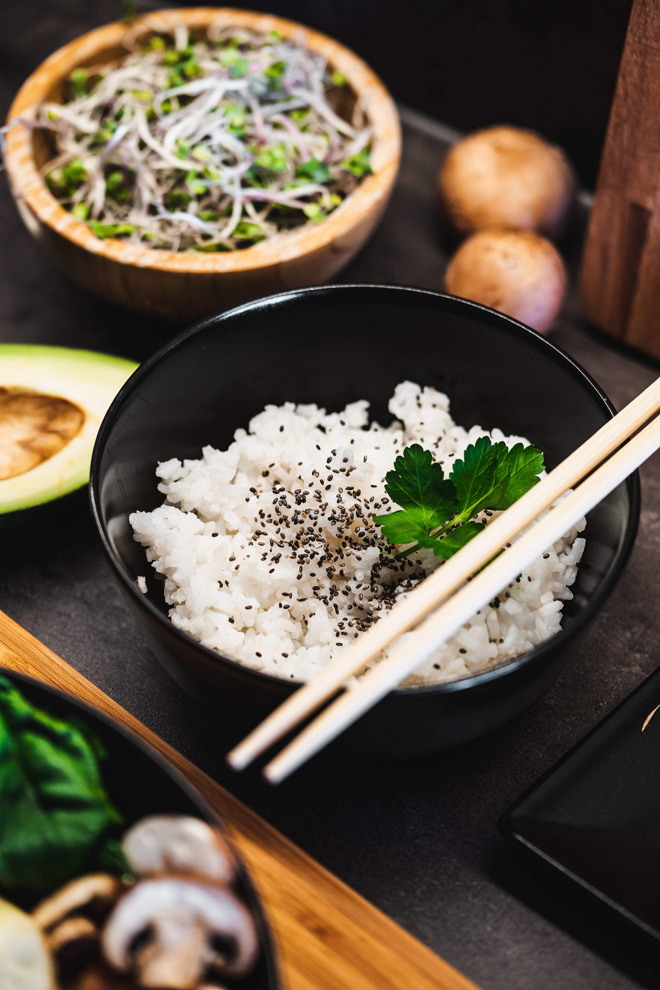 Cooked Jasmine Rice in a Dark Bowl with Chopsticks Free Stock Photo