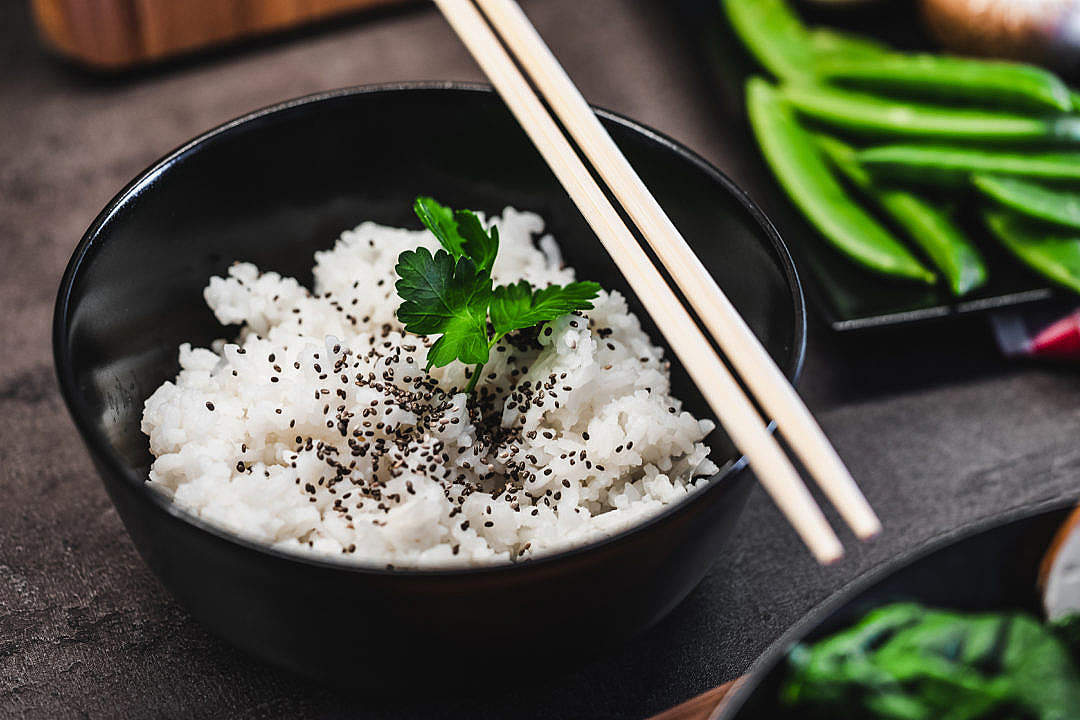 Download Cooked Jasmine Rice with Black Sesame and Chopsticks FREE Stock Photo
