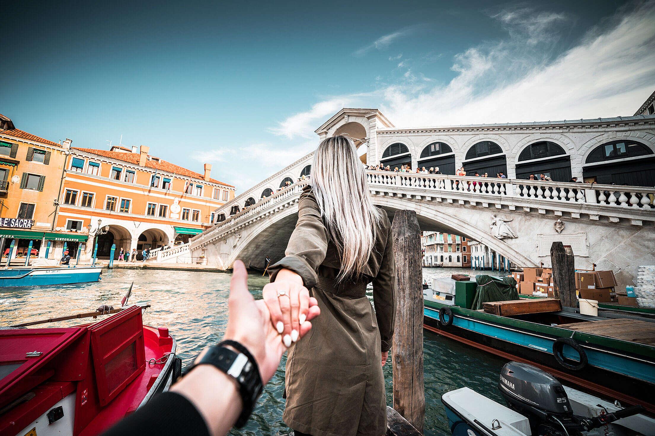 Couple in Follow Me To Pose in Front of Rialto Bridge, Venice Free Stock Photo