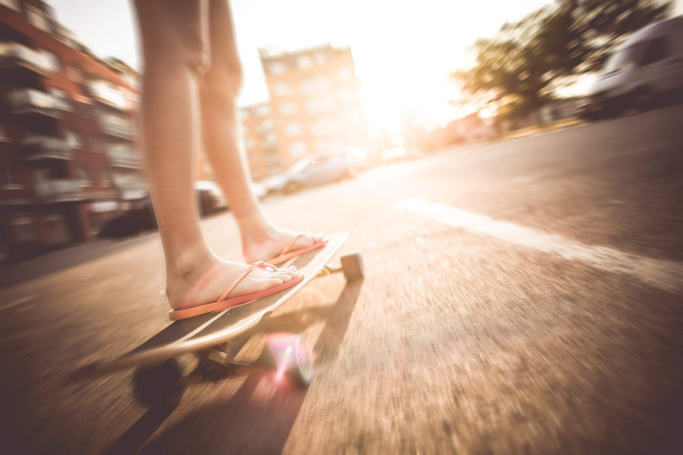Crazy Girl Riding Her Longboard in Flip Flops Free Stock Photo