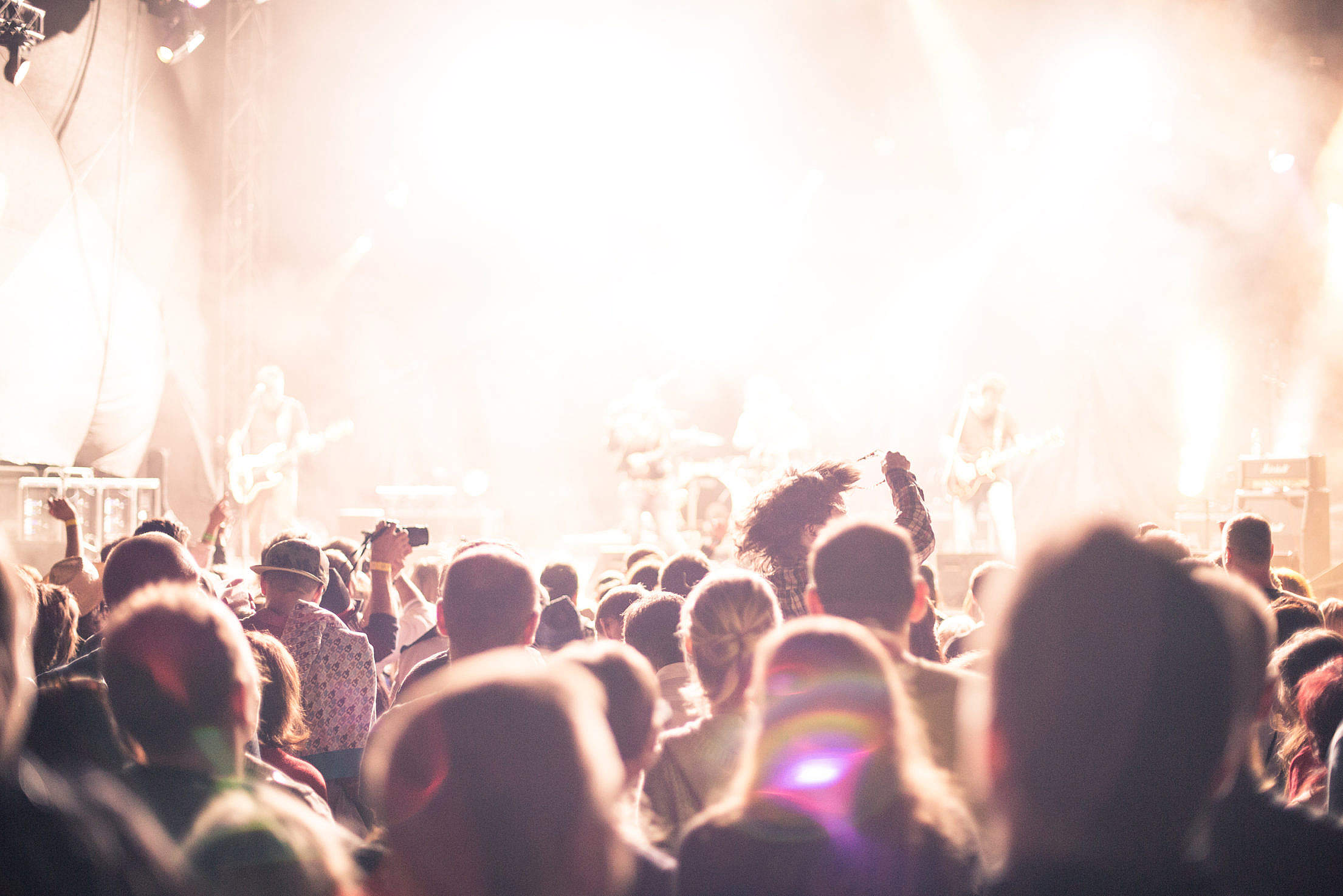 Crowds of Party People Enjoying a Live Concert Free Stock Photo