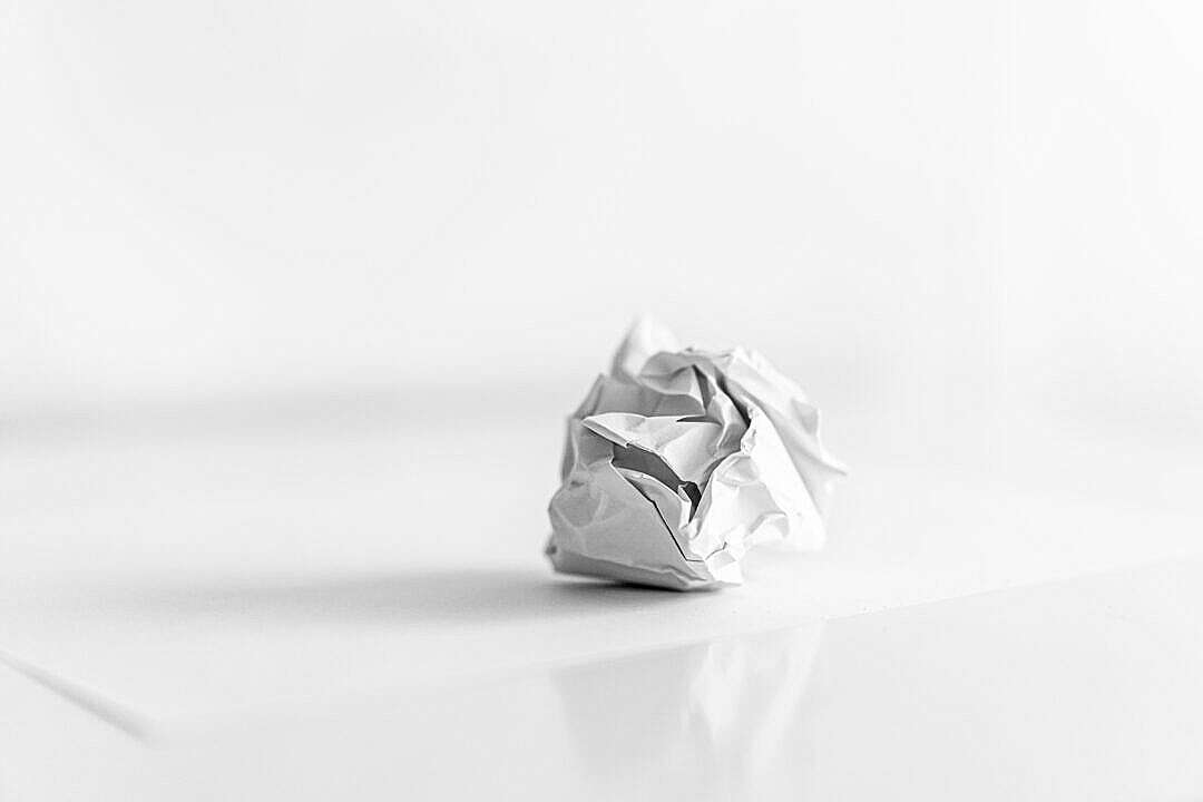 Download Crumpled Paper Ball on the Table FREE Stock Photo